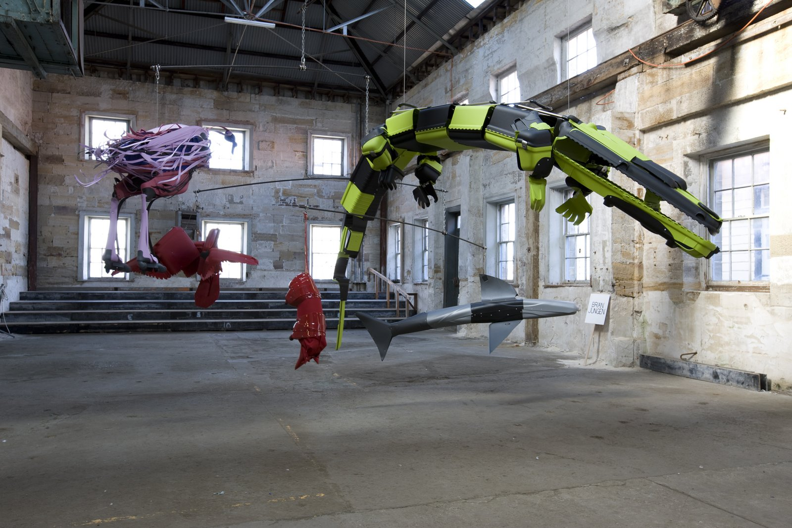 Brian Jungen,Crux (as seen from those who sleep on the surface of the earth under thenight sky), 2008,suspended mobile of steel, cut up travel suitcases, rowboat with oars installed on ground, dimensions variable. Installation view, SydneyBiennale,Sydney,Australia, 2008