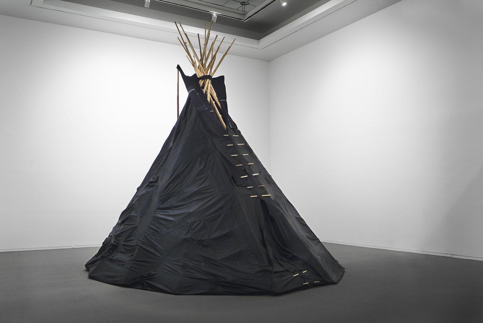 Brian Jungen,Furniture Sculpture, 2006,11 black leather couches, wood, 244 x 232 x 284 in. (620 x 589 x 721 cm)