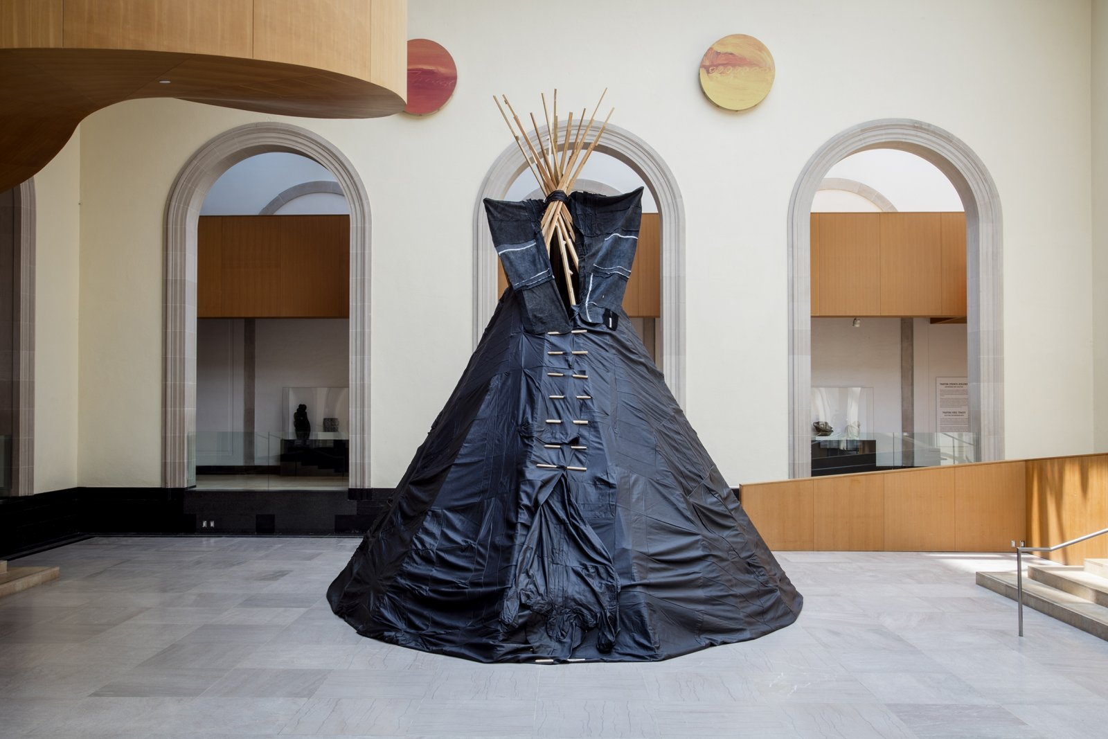 Brian Jungen, Furniture Sculpture, 2006, 11 black leather couches, wood, 244 x 232 x 284 in. (620 x 589 x 721 cm). Installation view, Art Gallery of Ontario, Toronto, Canada, 2019