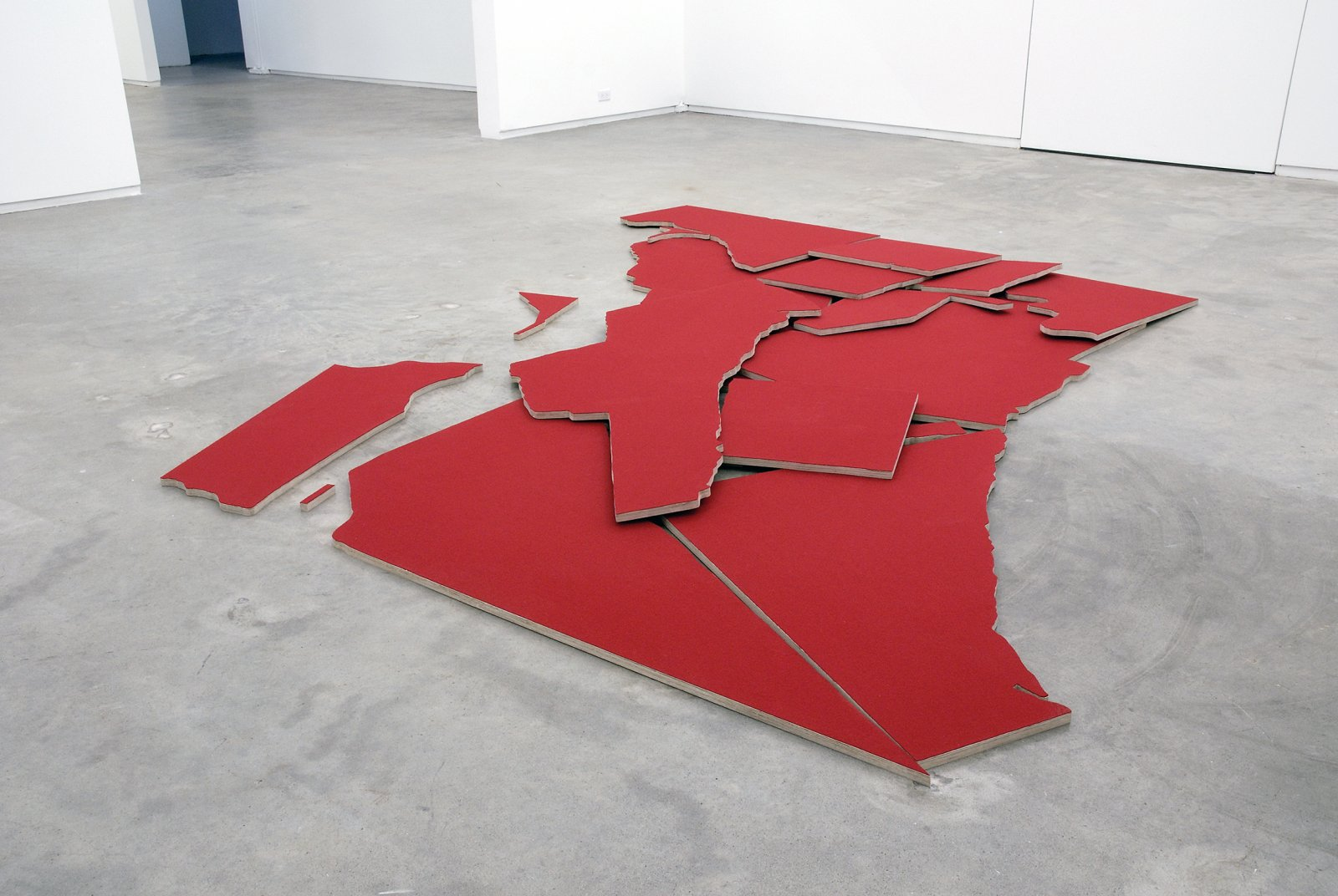 Brian Jungen,Greater Vancouver, 2007, 18 baltic plywood cutouts, wool fabric, 126 x 132 x 3 in. (320 x 335 x 8 cm)