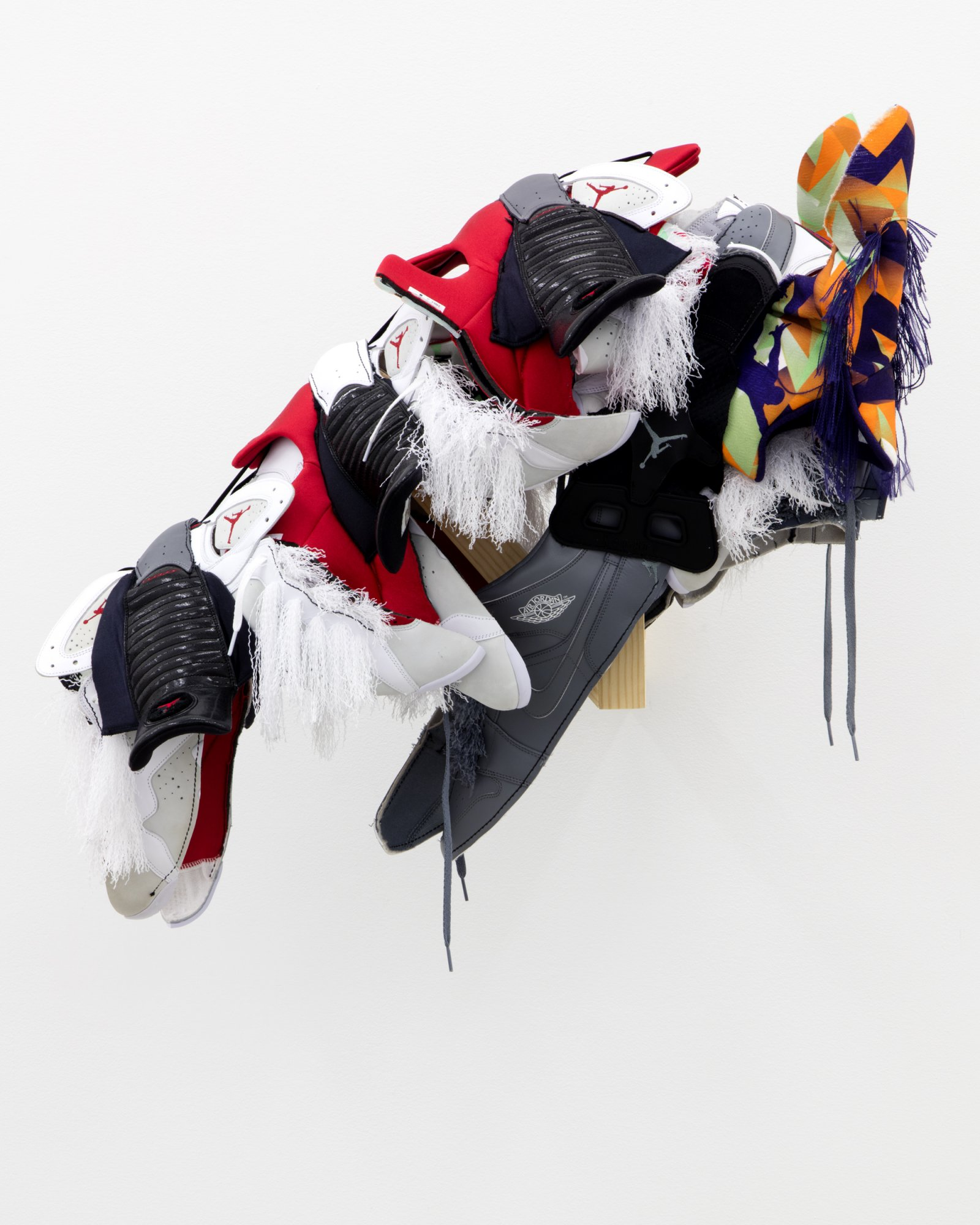Brian Jungen,Horse Mask (Mike), 2016, nike air jordans, 33 x 31 x 17 in.(84 x 78 x 43 cm). Courtesy Casey Kaplan, New York