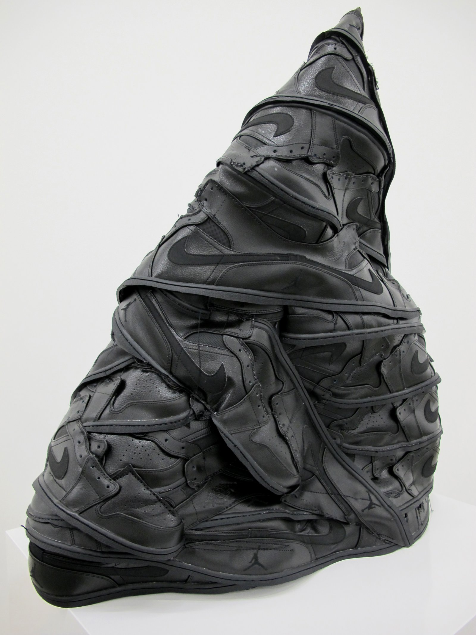 Brian Jungen,I ShallBe Released, 2015, nike air jordan shoes (black, #1), 29 x 26 x 12 in. (74 x 66 x 31 cm)
