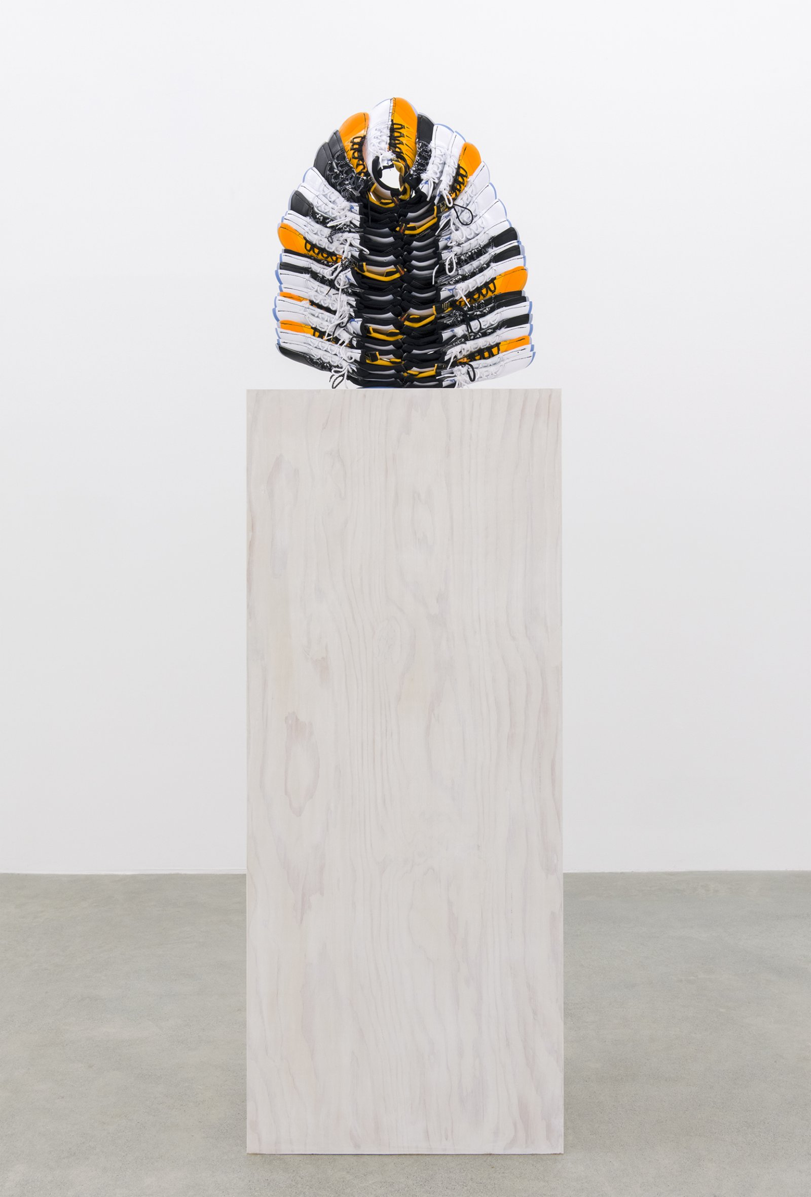 Brian Jungen, Lay Down Tender Fire, 2015–2016, nike air jordans, painted fir plywood, stainless steel, 100 x 17 x 24 in. (254 x 43 x 61 cm) by Brian Jungen