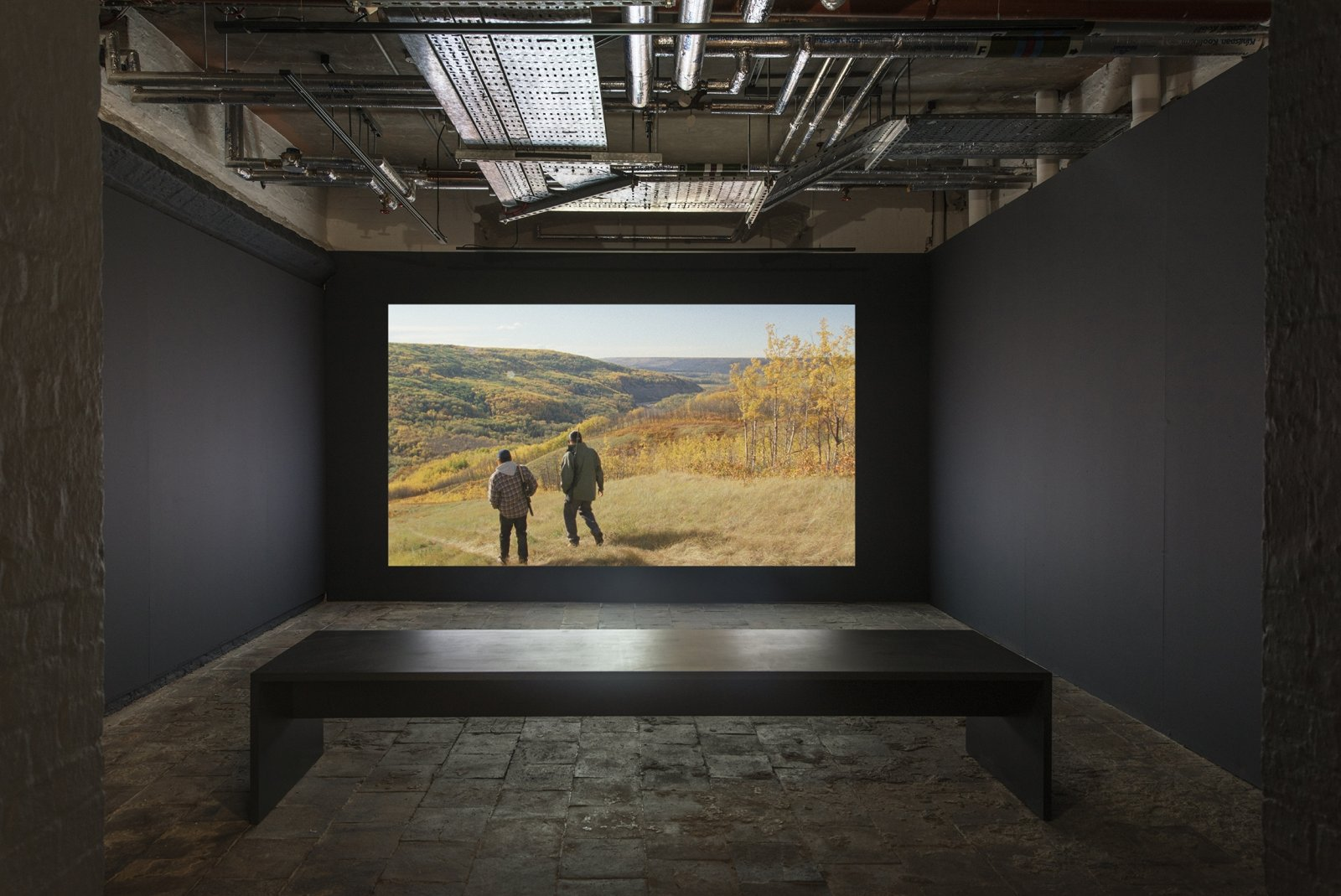 Brian Jungen and Duane Linklater, Modest Livelihood, 2012, super 16mm film, transferred to blu-ray, 50 minutes, silent. Installation view, Beautiful world, where are you?, St. George's Hall, Liverpool Biennial, 2018