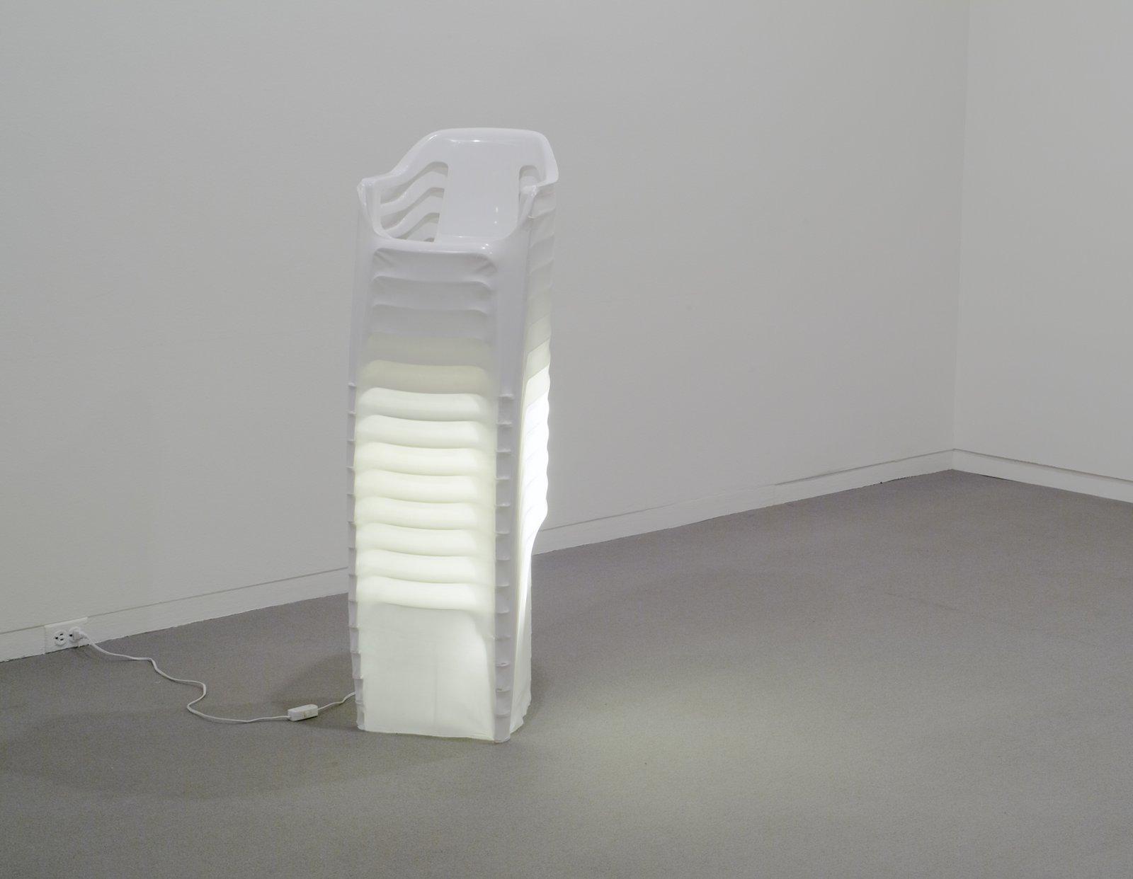 Brian Jungen,Mise en scene, 2000, plastic chairs, polyethylene, fluorescent lights, 51 x 15 x 14 in. (128 x 38 x 34 cm)