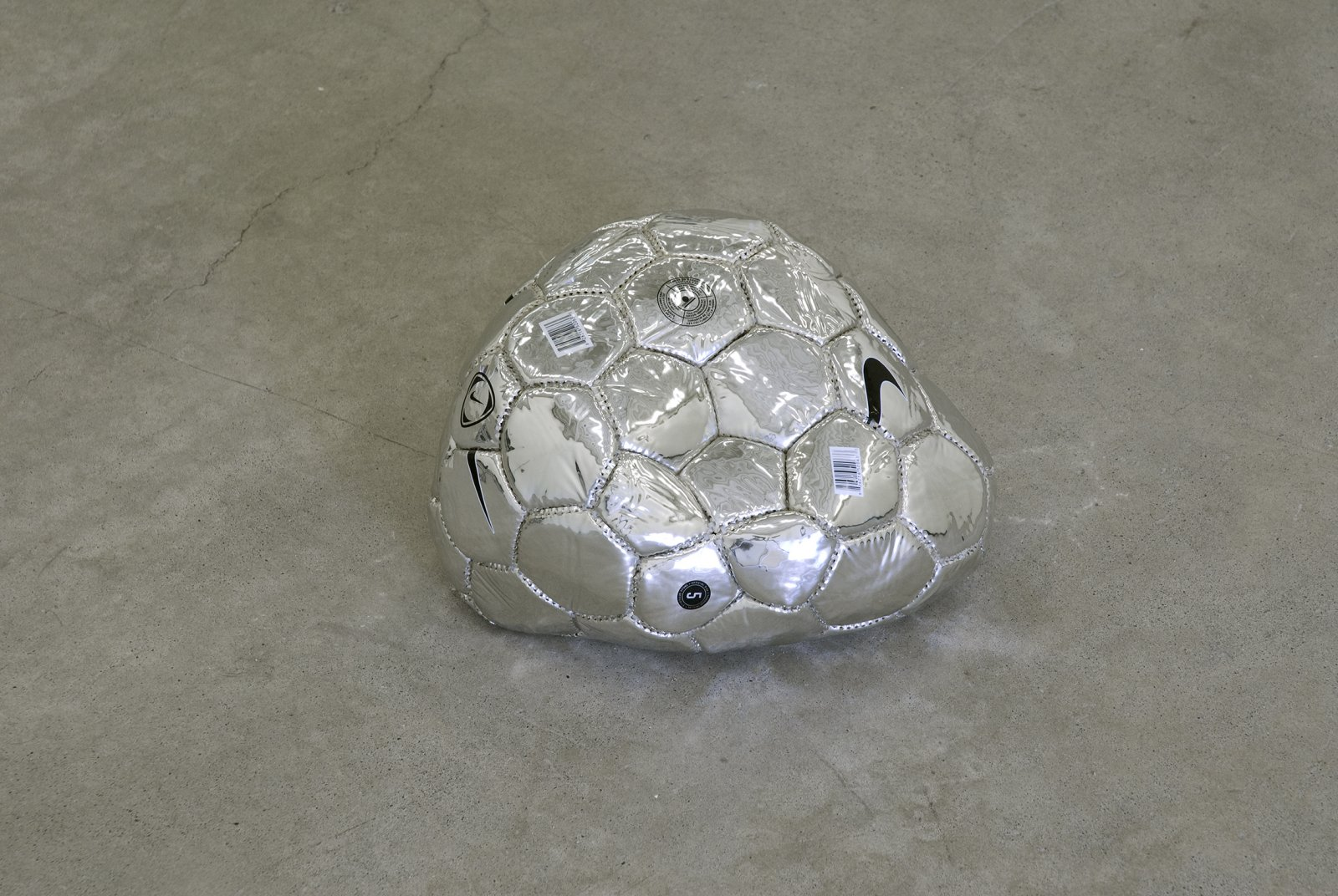 Brian Jungen,Modern Sculpture (After Iceland)(detail), 2005, 6 sculptural forms of lava rock and soccer balls, dimensions variable