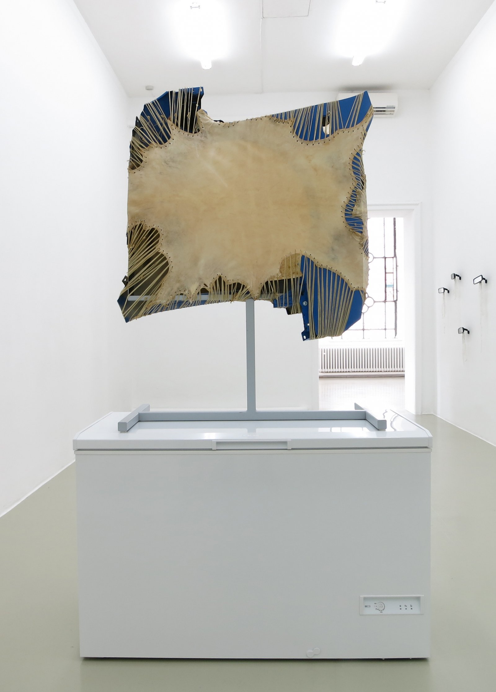 Brian Jungen,Mother Tongue, 2013, steel, deer hide, vw fenders, freezer, 100 x 51 x 28 in. (256 x 130 x 71 cm)
