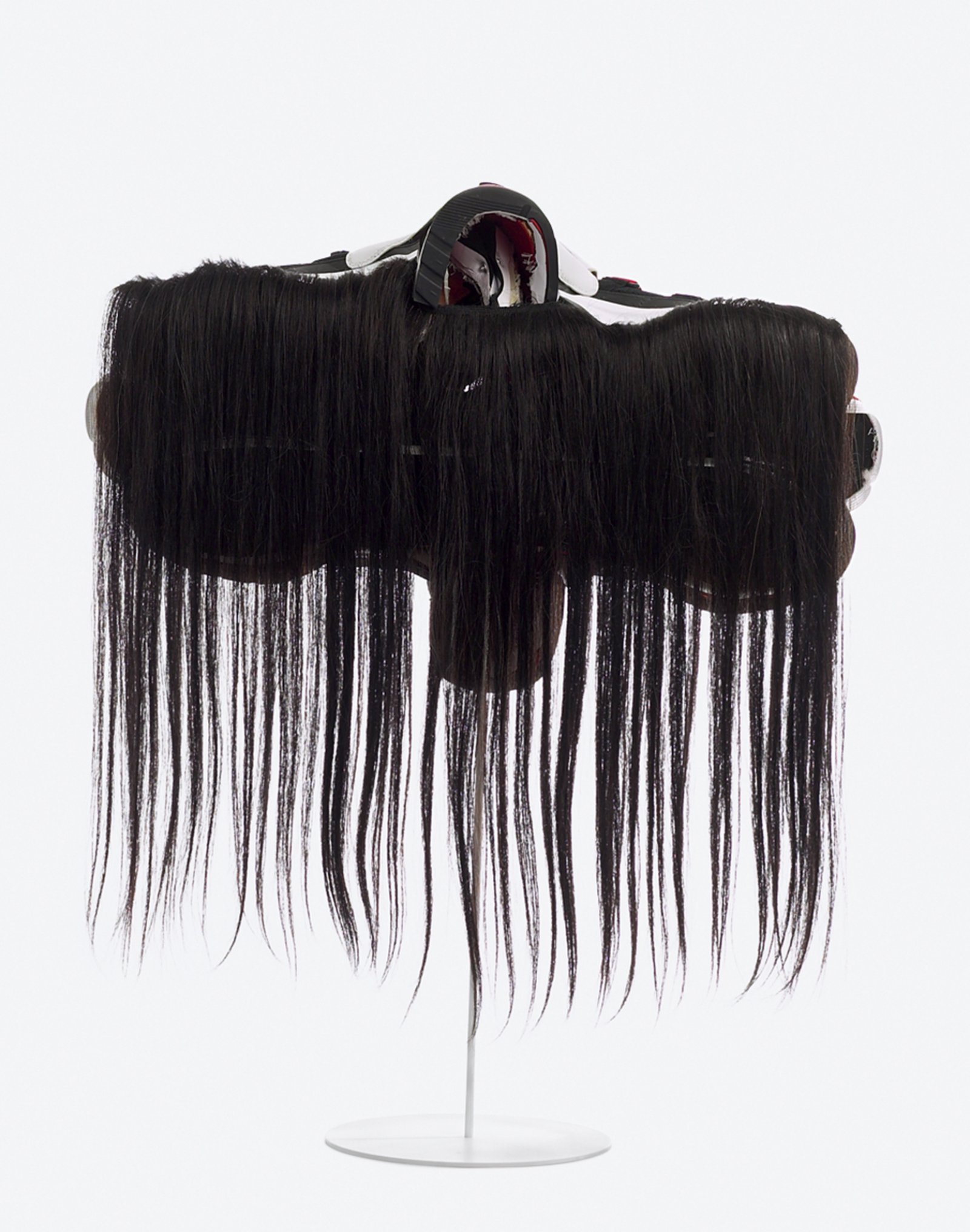Brian Jungen,Prototype for New Understanding #11, 2002, nike air jordans, human hair, 26 x 23 x 10 in. (67 x 58 x 25 cm)