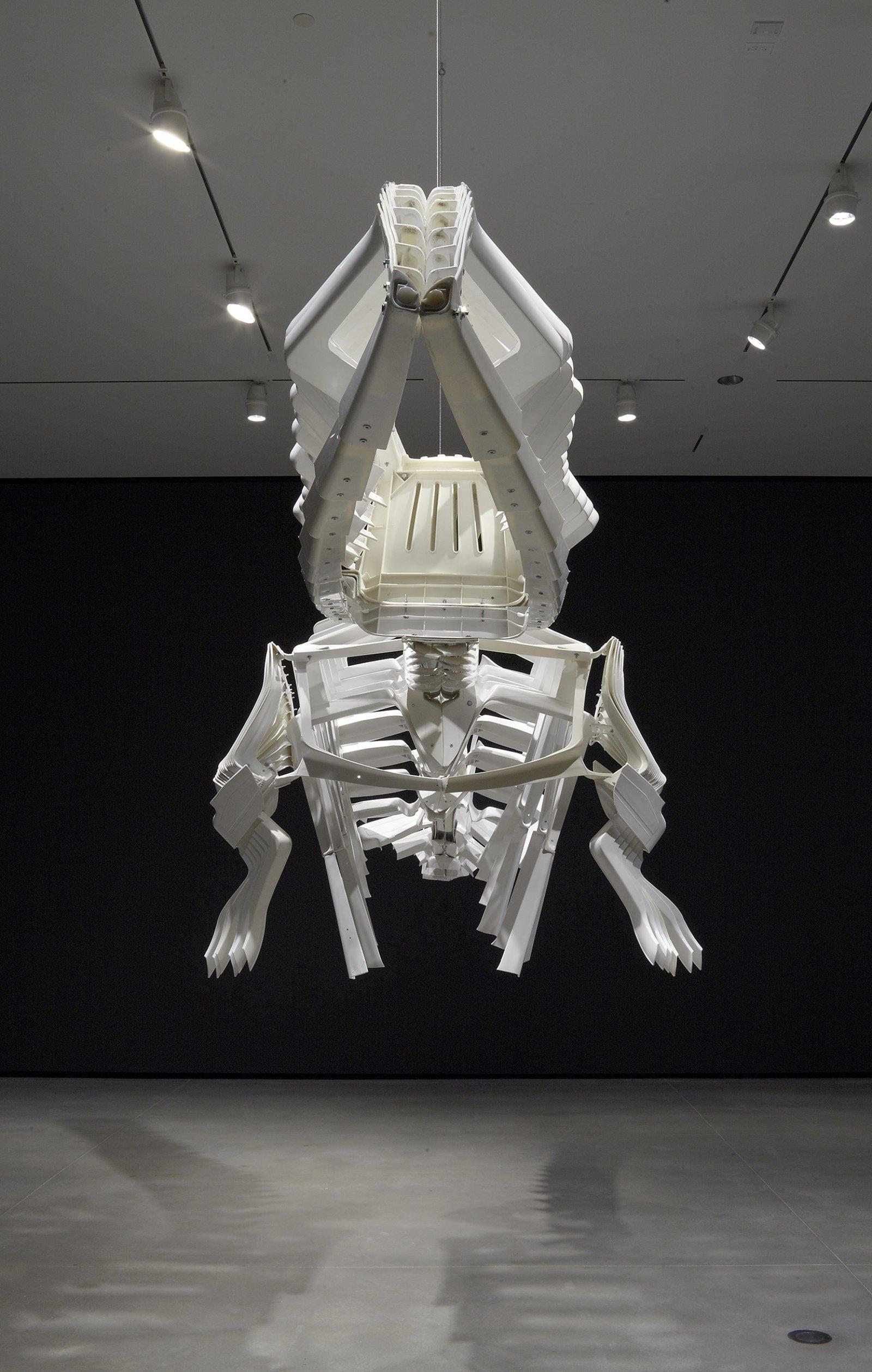 Brian Jungen,Shapeshifter, 2000, plastic chairs, 57 x 60 x 260 in. (145 x 152 x 660 cm). Installation view, Art Gallery of Alberta,Edmonton, AB, 2011