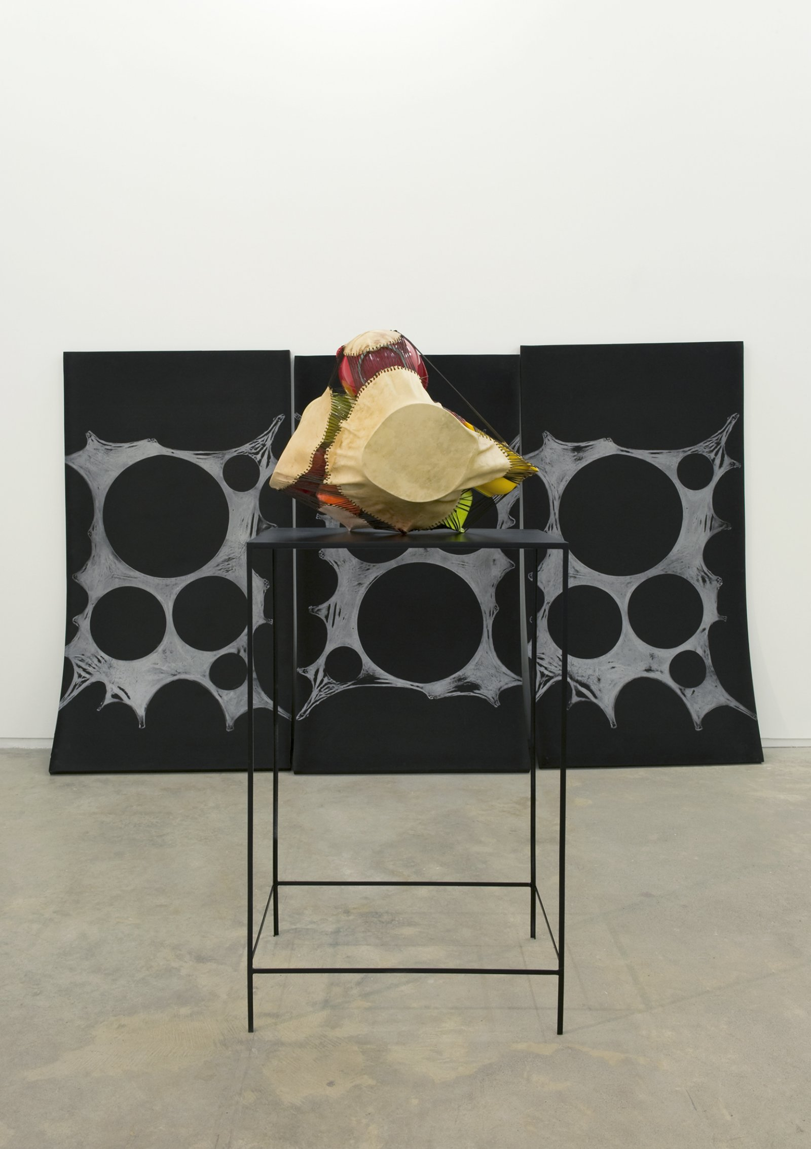 Brian Jungen,Subject, Silver, Prism, 2011,foam, silver relief ink, plastic bowls, deer hide, tarred twine, steel, 78 x 120 x 300 in. (198 x 305 x 762 cm)