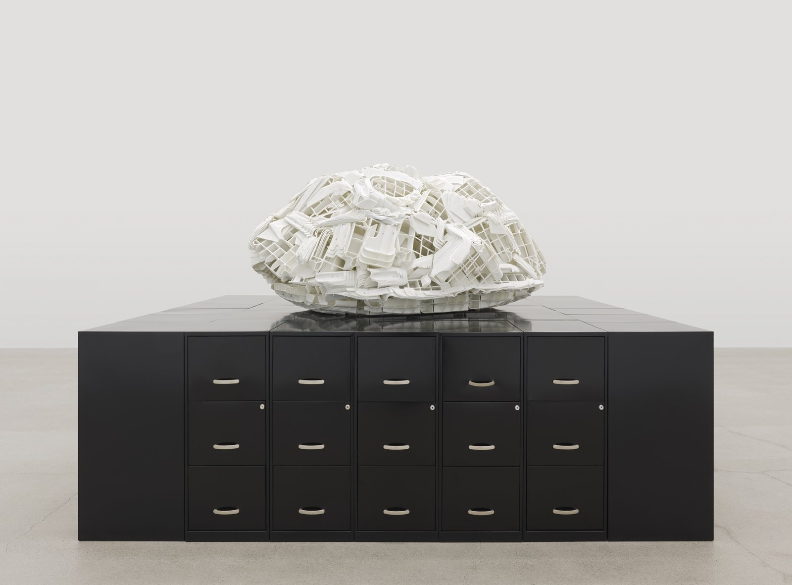 Brian Jungen, Tombstone, 2019, rubbermaid step stools, filing cabinets, 69 x 107 x 86 in. (174 x 272 x 217 cm)