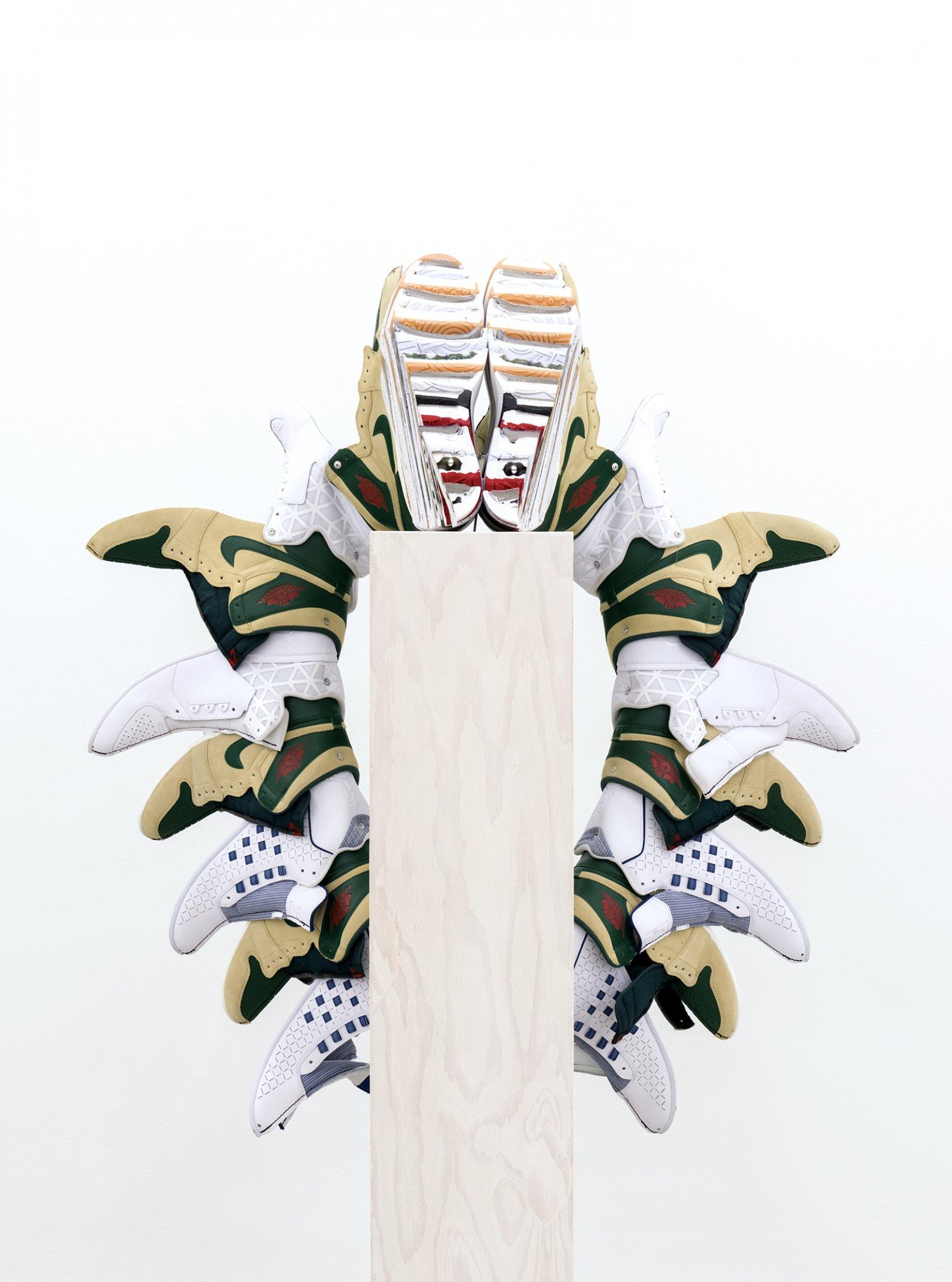 Brian Jungen, Walk This Way (Fall), 2015–2016, nike air jordans, painted fir plywood, stainless steel, 75 x 24 x 24 in. (191 x 61 x 61 cm) by Brian Jungen
