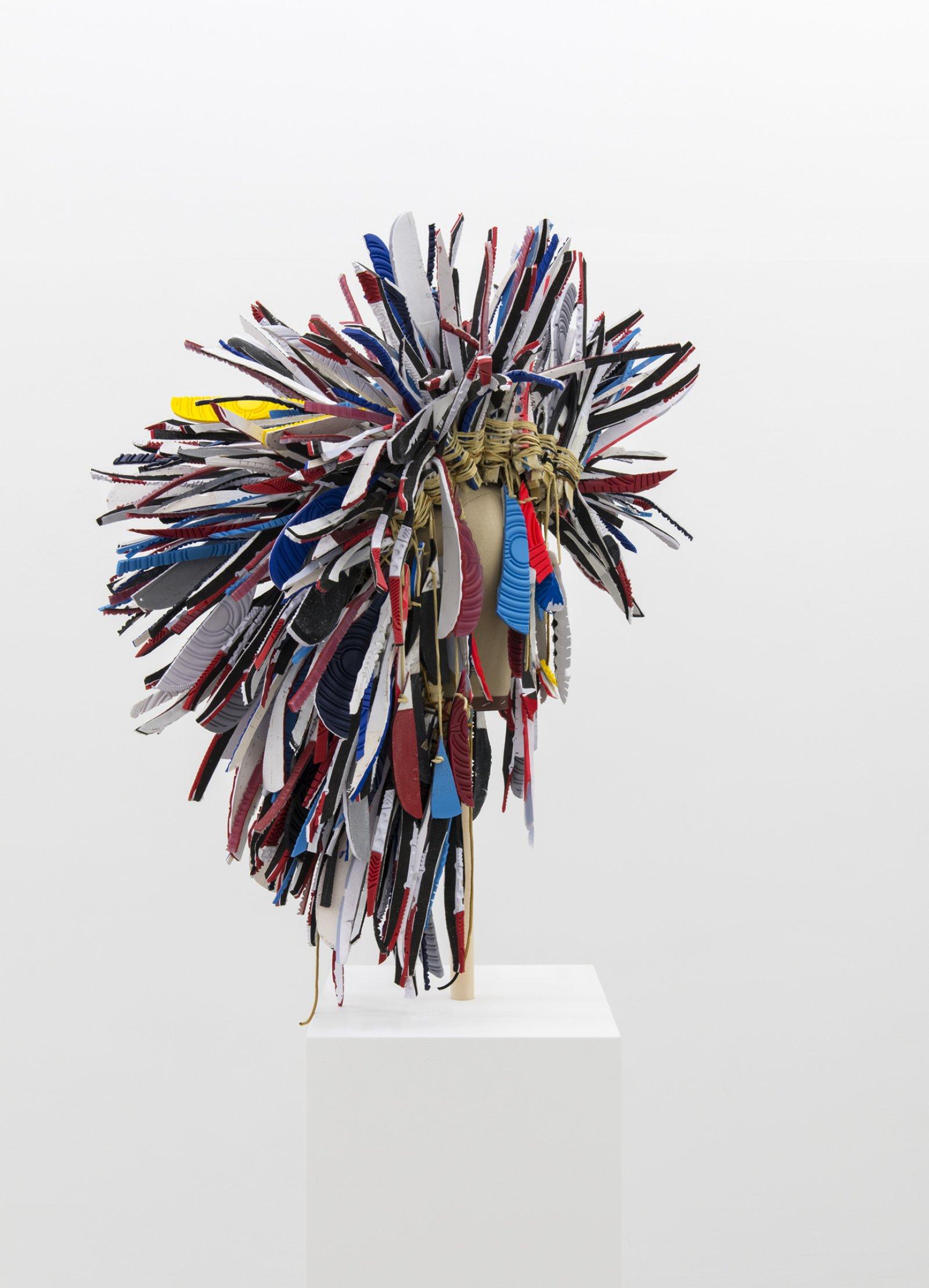 Brian Jungen,Warrior 2, 2017, nike air jordans, hide glue, deerskin, 77 x 29 x 24 in. (196 x 74 x 61 cm)