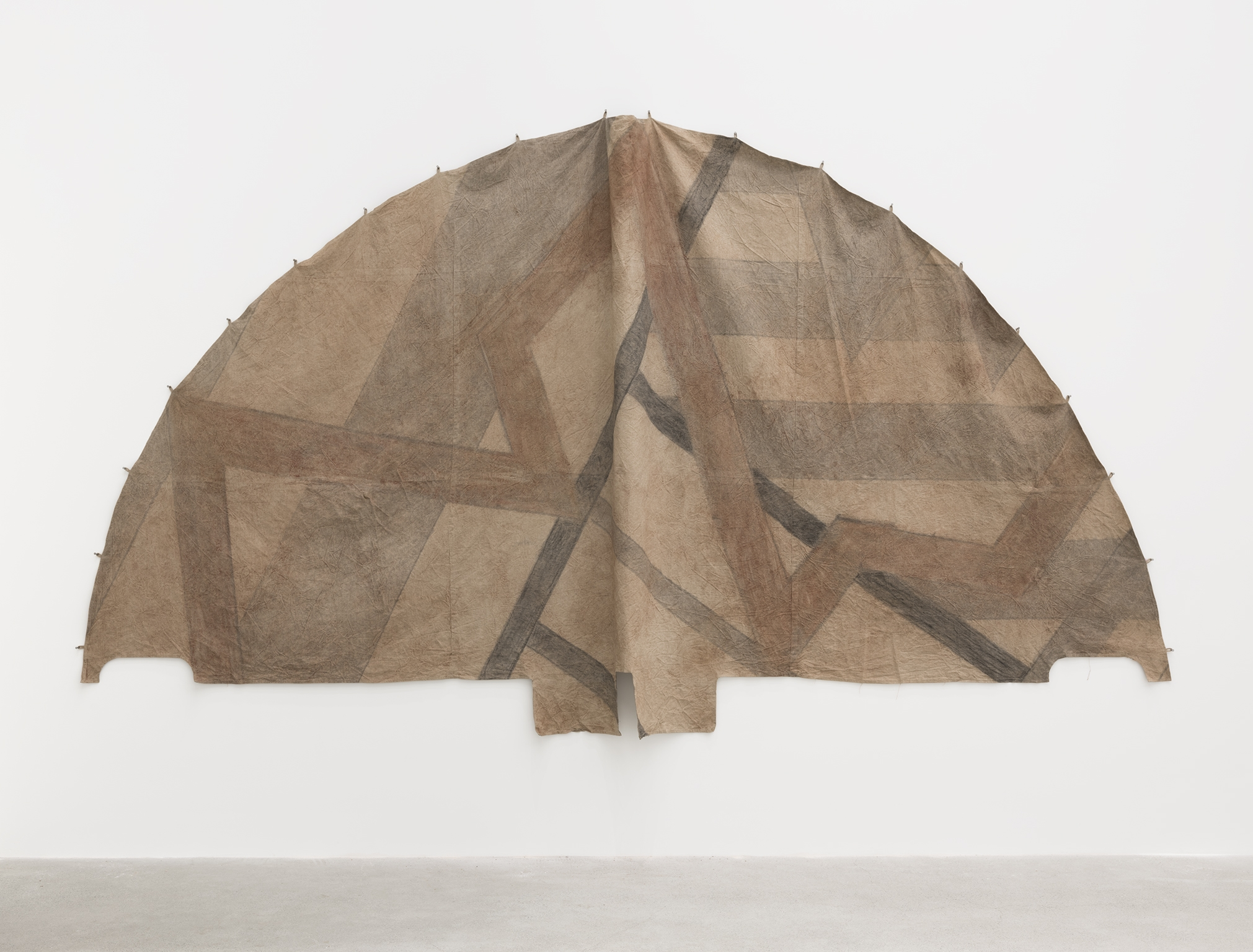 ​Duane Linklater, Tipi cover for new old geometries / little door for Sassa, 2018, digital print on hand-dyed linen, sumac, charcoal, nails, 110 x 210 in. (278 x 533 cm) by