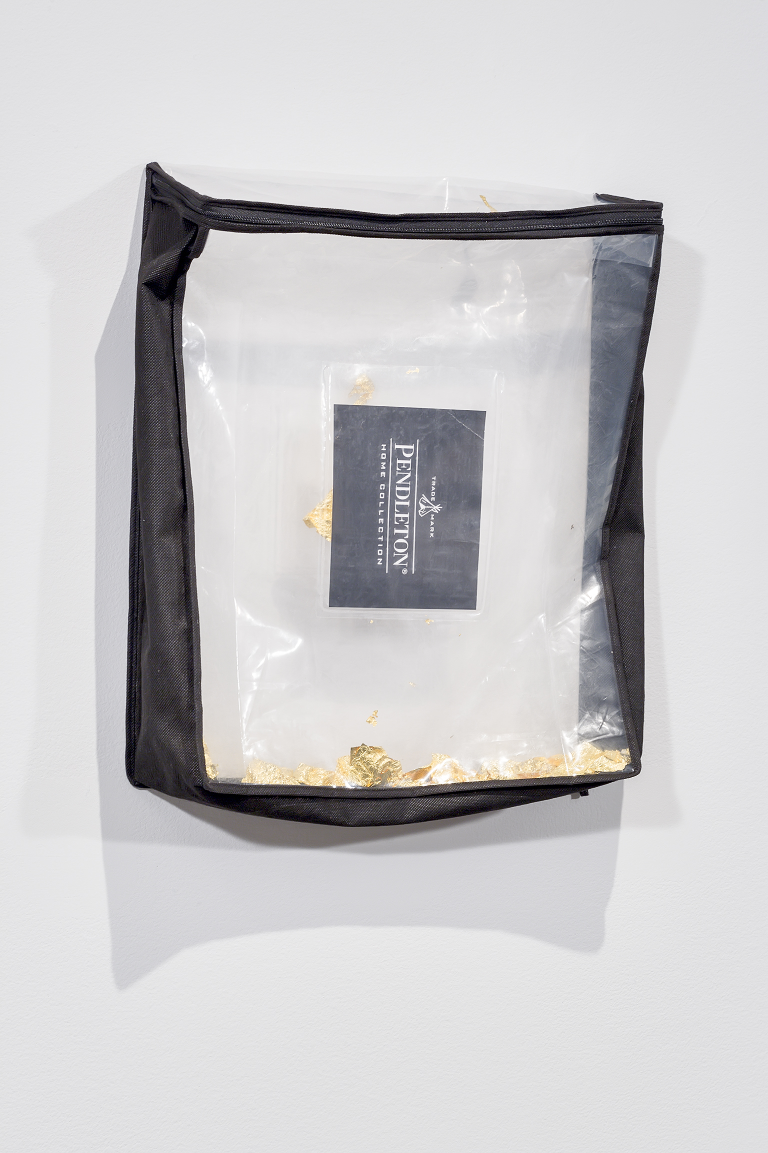 Duane Linklater, Trademark, 2016, gold leaf, plastic bag, 19 x 16 x 4 in. (48 x 40 x 9 cm) by
