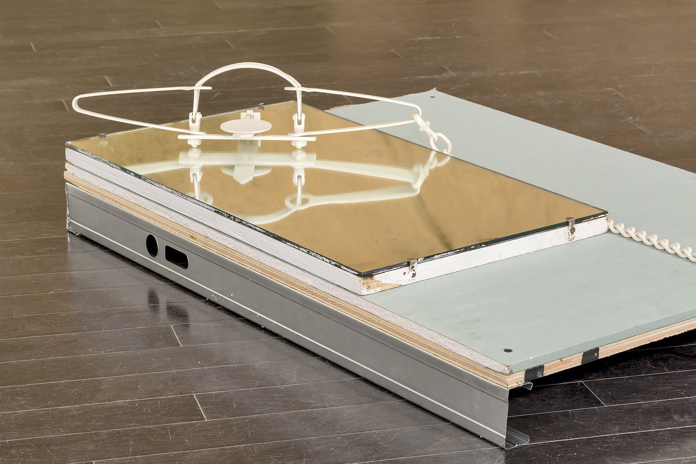 Duane Linklater, Trap (detail), 2016, powder-coated trap, mirror, gypsum, wood, dimensions variable by