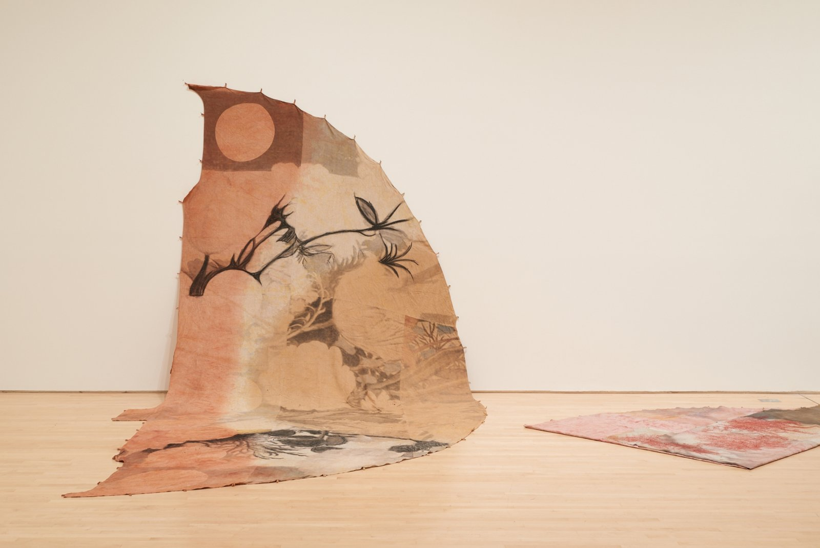 Duane Linklater, can the circle be unbroken 3, 2019, digital print on linen, iron red dye, cypress yellow ochre, black walnut dye, black tea, charcoal, installation dimensions variable. Installation view, SOFT POWER, SF MOMA, San Francisco, USA, 2019 by Duane Linklater