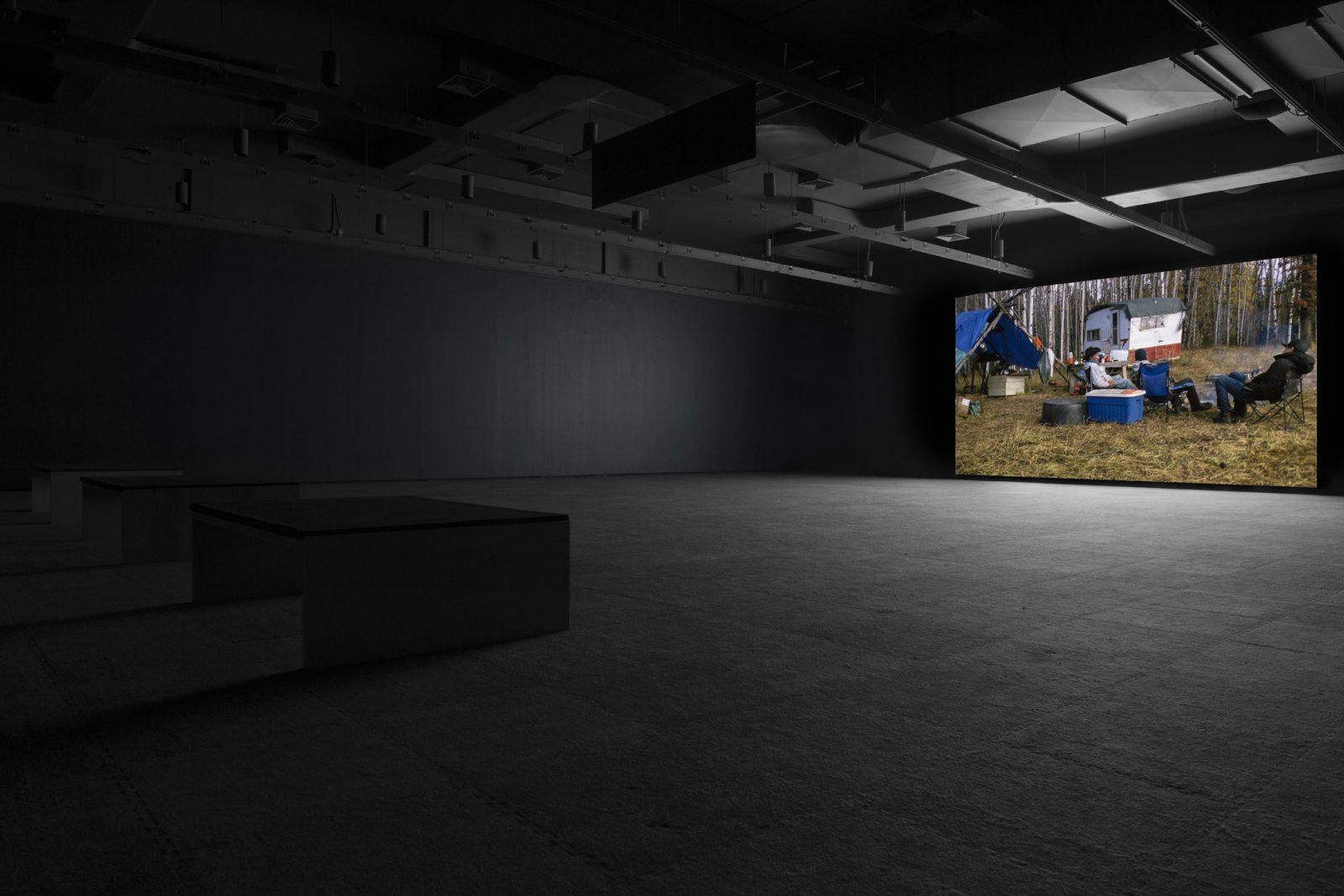 Brian Jungen and Duane Linklater, Modest Livelihood, 2012, super 16mm film, transferred to blu-ray, 50 minutes, silent. Installation view, Walter Phillips Gallery, Banff, 2012.
