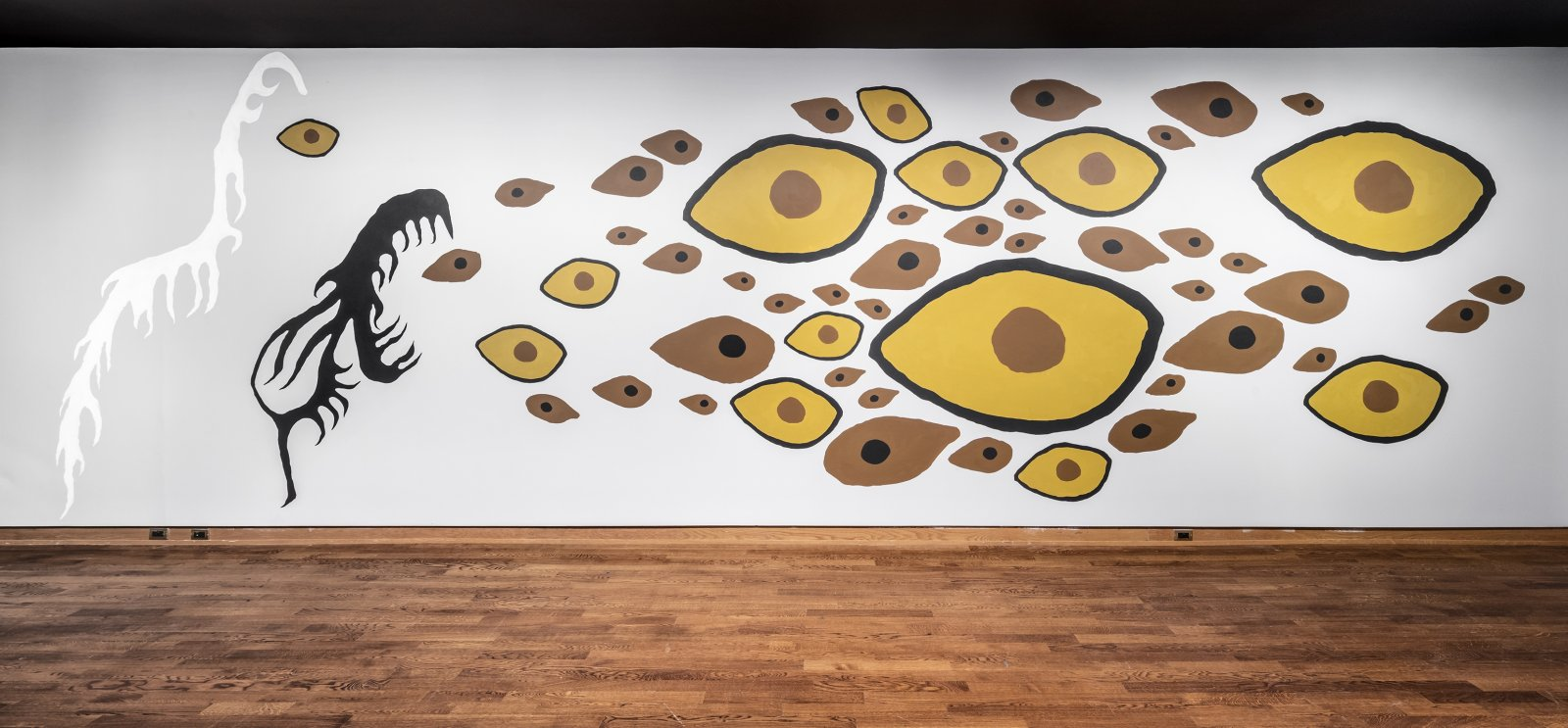 Duane Linklater, Earth Mother Hair, Indian Hair, and Earth Mother Eyes, Indian Eyes, Animal Eyes, 2017, paint on interior wall of the Art Museum at the University of Toronto, from a series of small paintings of eyes and hair based on a photo of Norval Morrisseau's Earth Mother and Her Children (1967), painting labour by John Abrams, absence of the artist, dimensions variable. Installation view, In Dialogue, Art Museum, Toronto, Canada, 2017