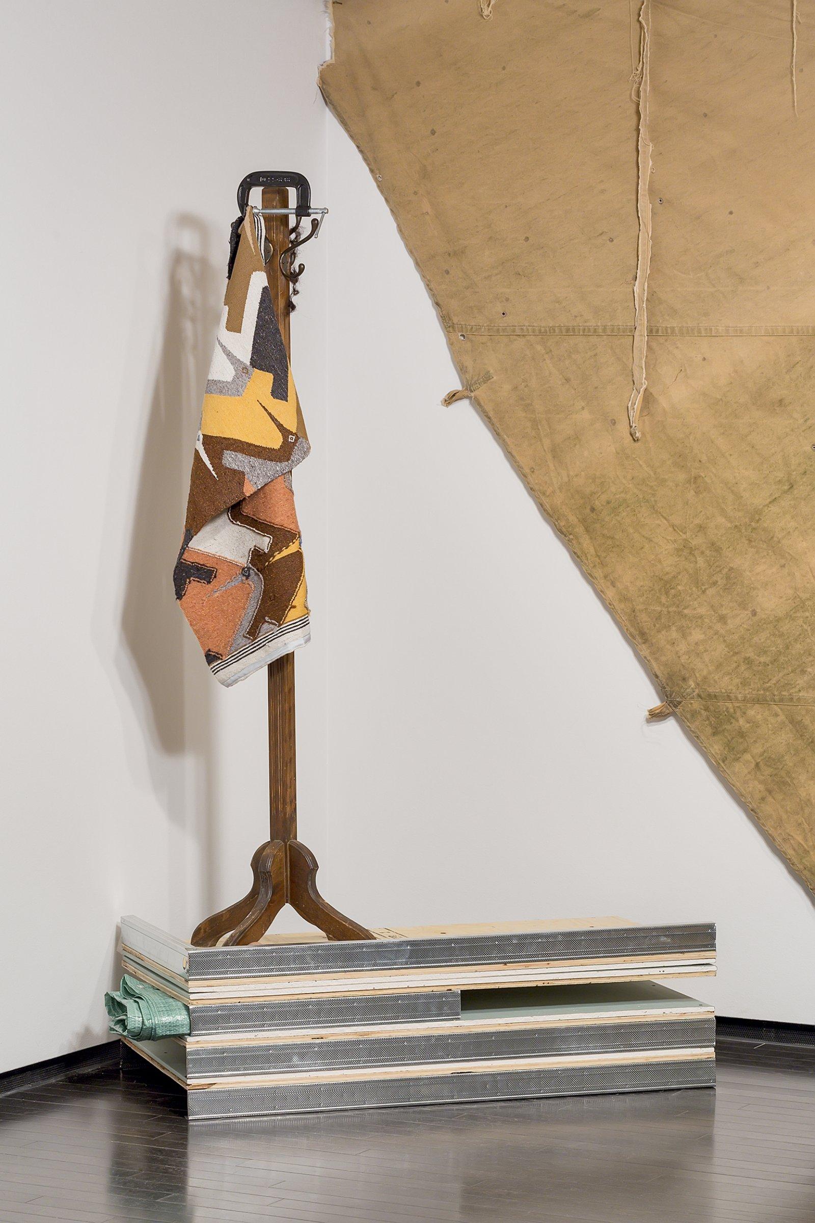 Duane Linklater, Flock, 2016, wool tapestry, coathanger, steel vice, tarpaulin, gypsum, wood, steel, hair, clay, dimensions variable