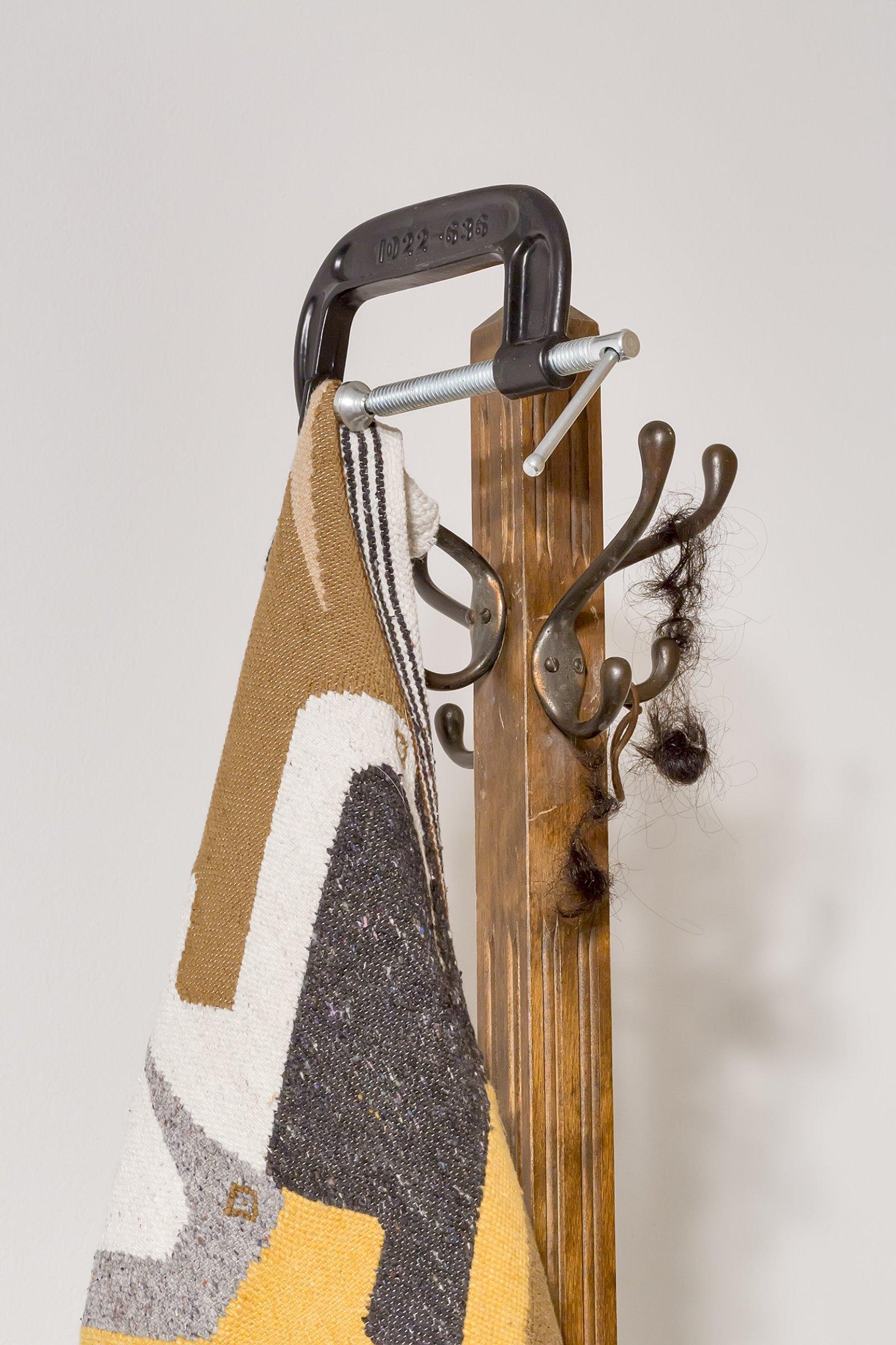 Duane Linklater, Flock (detail), 2016, wool tapestry, coathanger, steel vice, tarpaulin, gypsum, wood, steel, hair, clay, dimensions variable