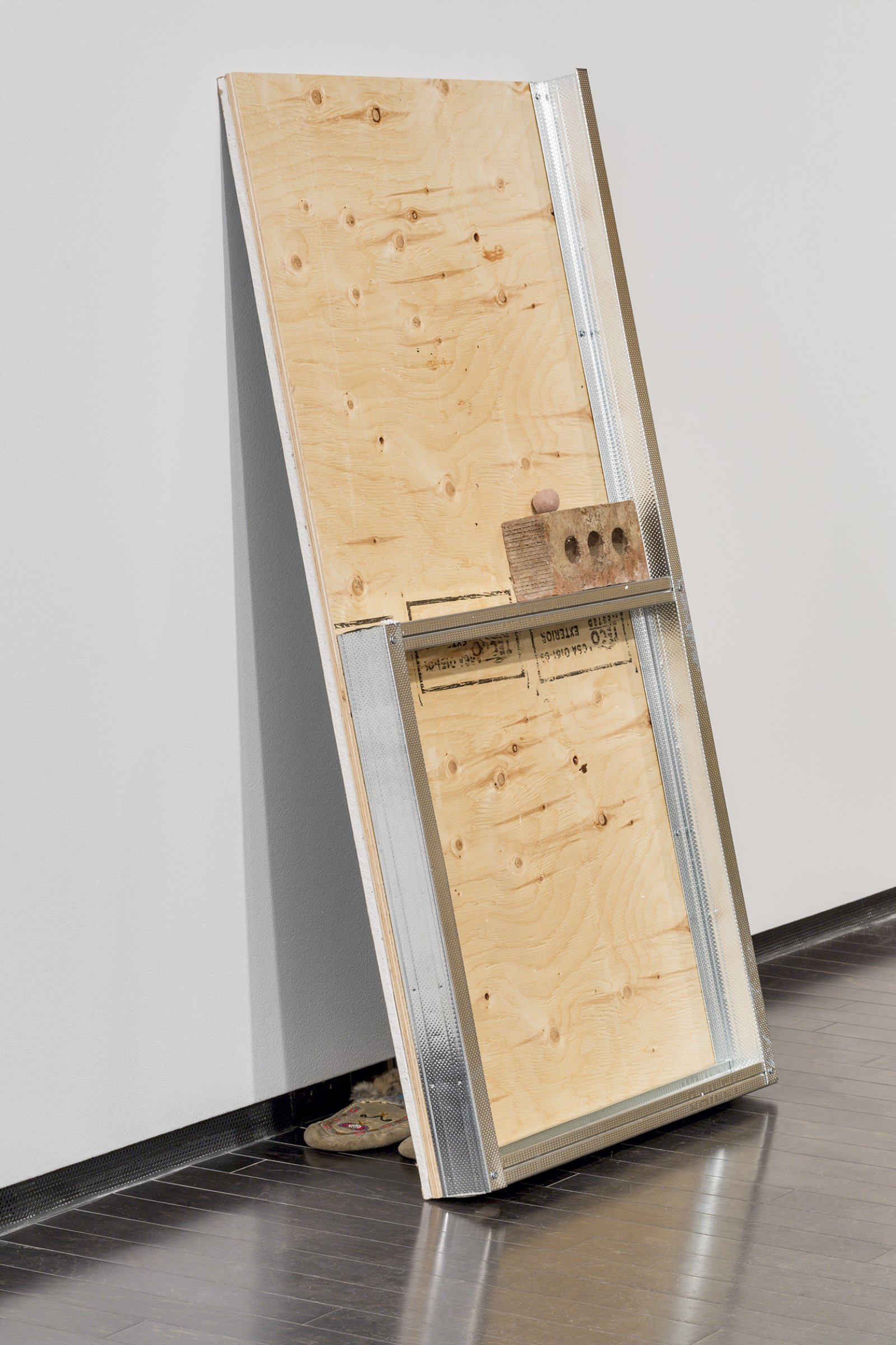 Duane Linklater, Id (detail), 2016, drywall, plywood, steel framing, clay, found brick, moose hide moccasins two wall components,  each: 48 x 5 x 24 in. (121 x 13 x 61 cm)