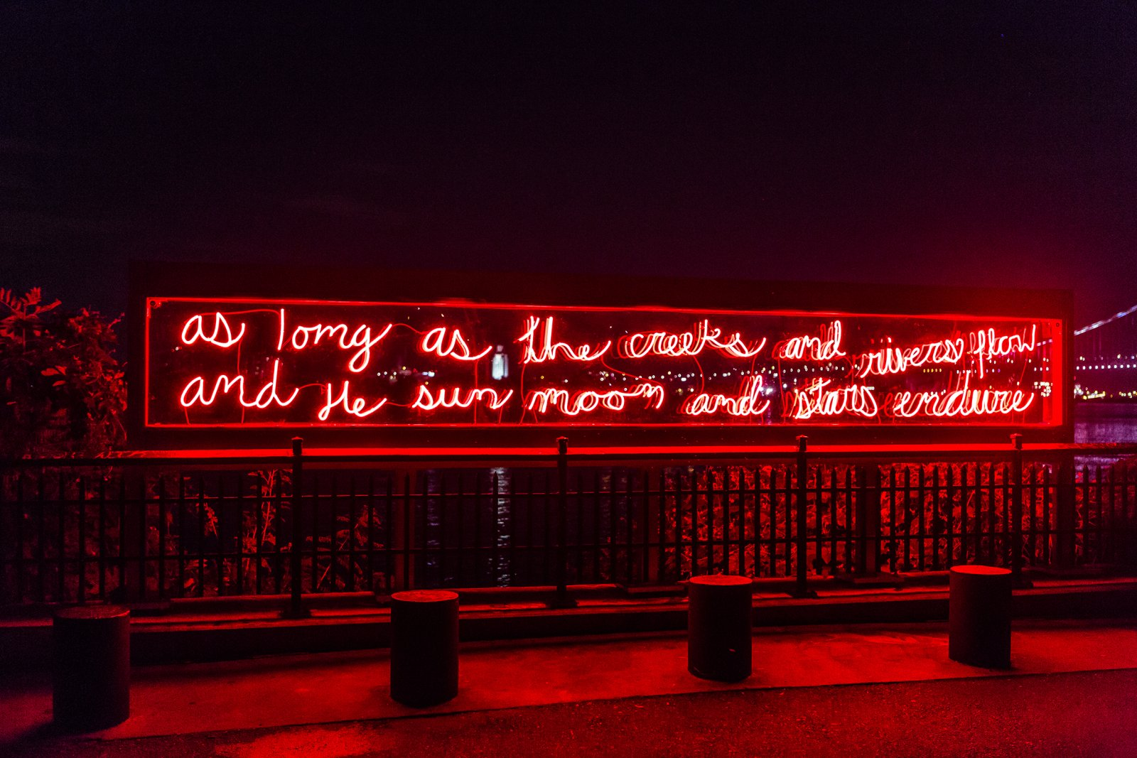 Duane Linklater, In Perpetuity, 2017, neon, transformers, aluminum, polycarbonate, and handwritten text by Sassa Linklater, 59 x 360 x 9 in. (150 x 914 x 23 cm). Installation view, Monument Lab: A Public Art and History Project, Mural Arts Philadelphia at Penn Treaty Park, Philadelphia, 2017
