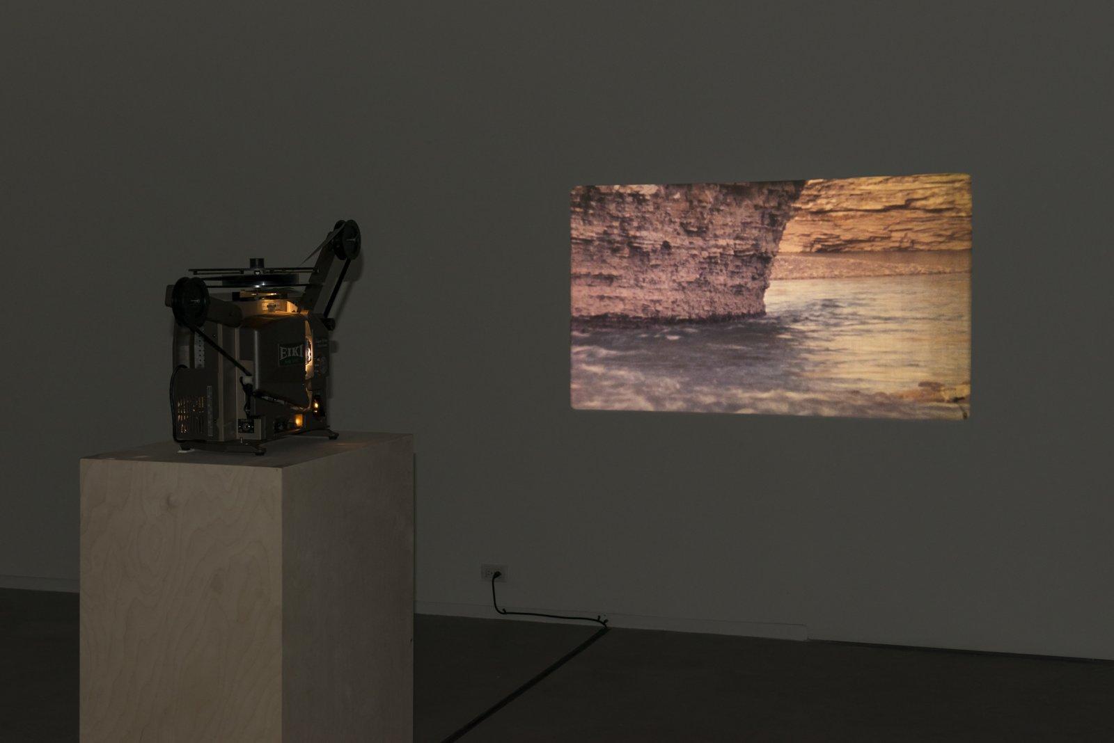 Brian Jungen and Duane Linklater, Stalker, 2013, super 16 mm film loop on projector, 2 minutes, 54 seconds