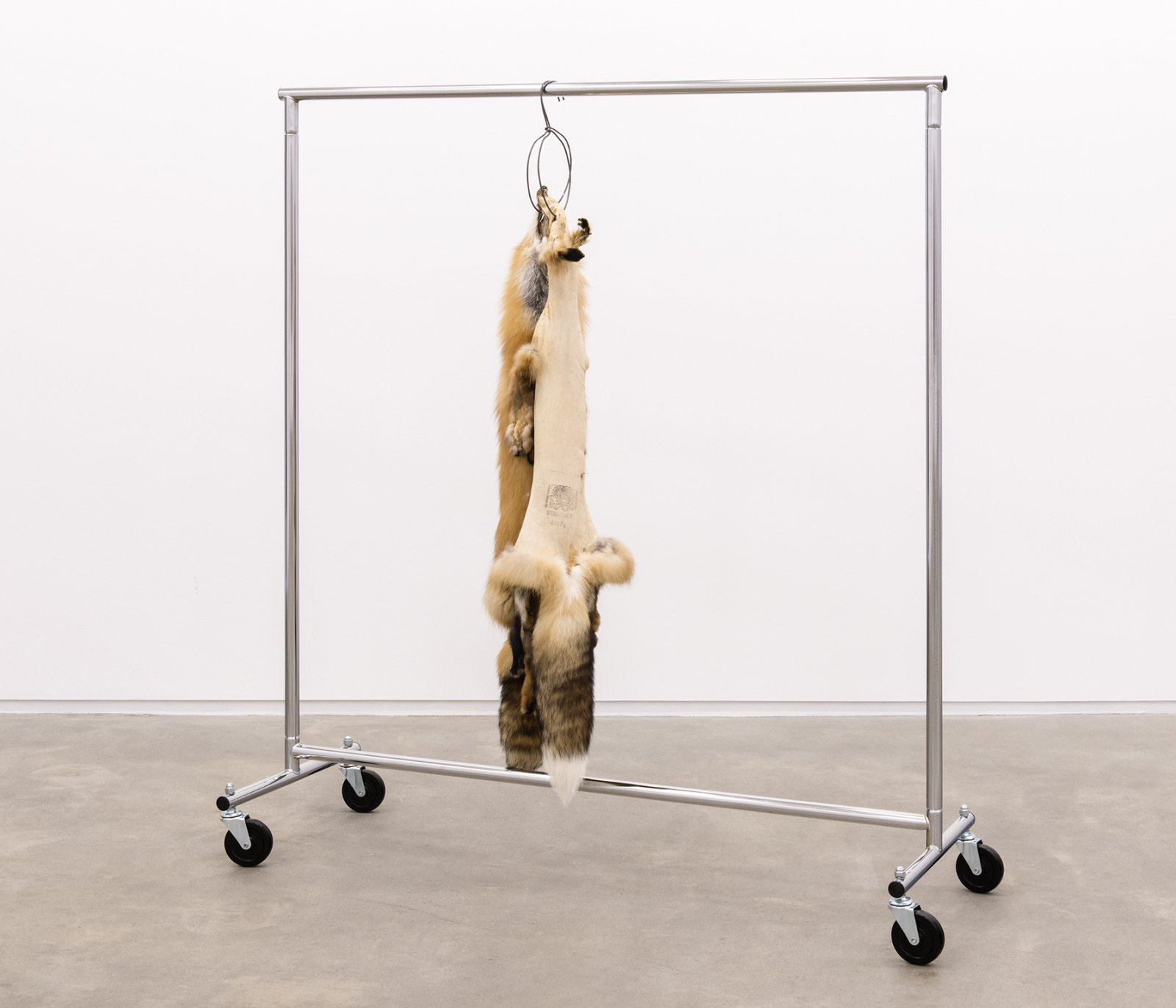 Duane Linklater, Kiss, 2014, fox furs, garment rack, hangers, 66 x 60 x 20 in. (168 x 151 x 52 cm)
