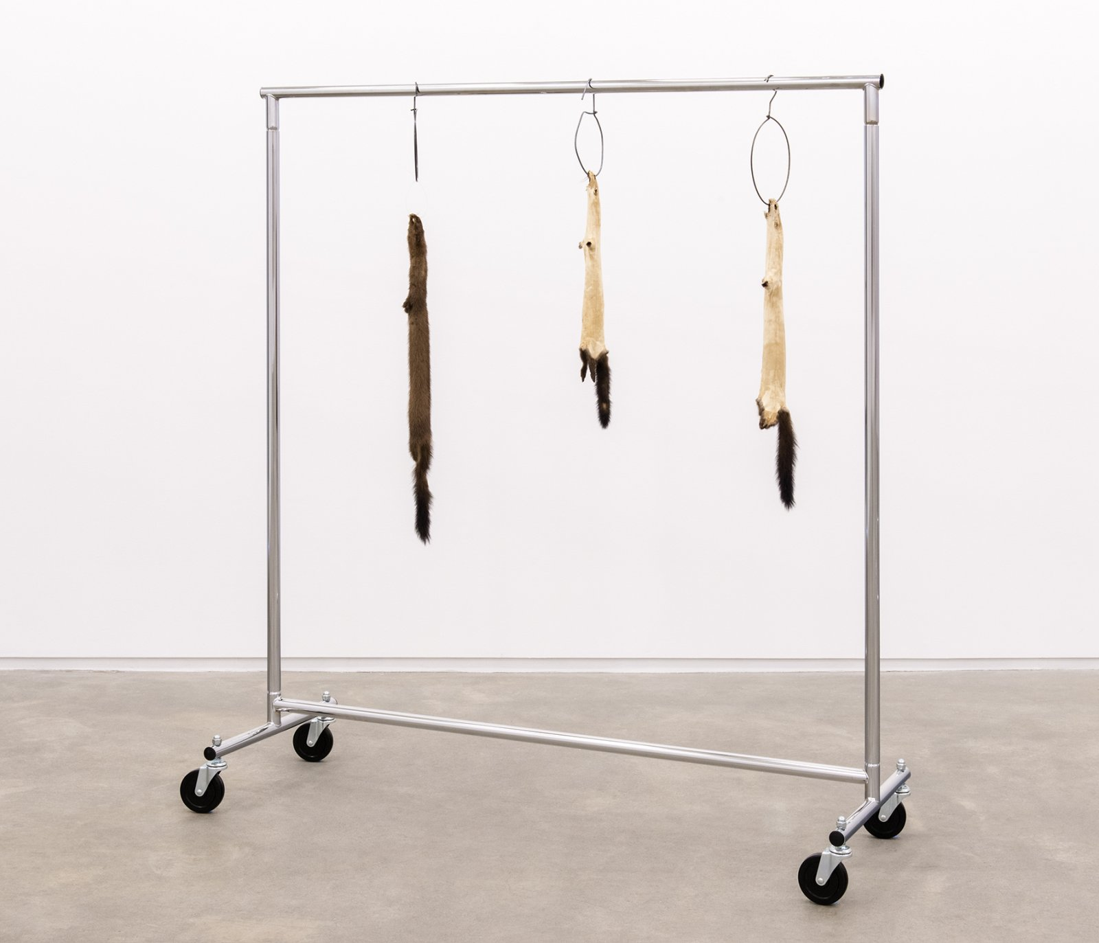 Duane Linklater, Little ghosts, 2014, mink furs, garment rack, plastic cable tie, hangers, 66 x 60 x 20 in. (168 x 151 x 52 cm) by Duane Linklater