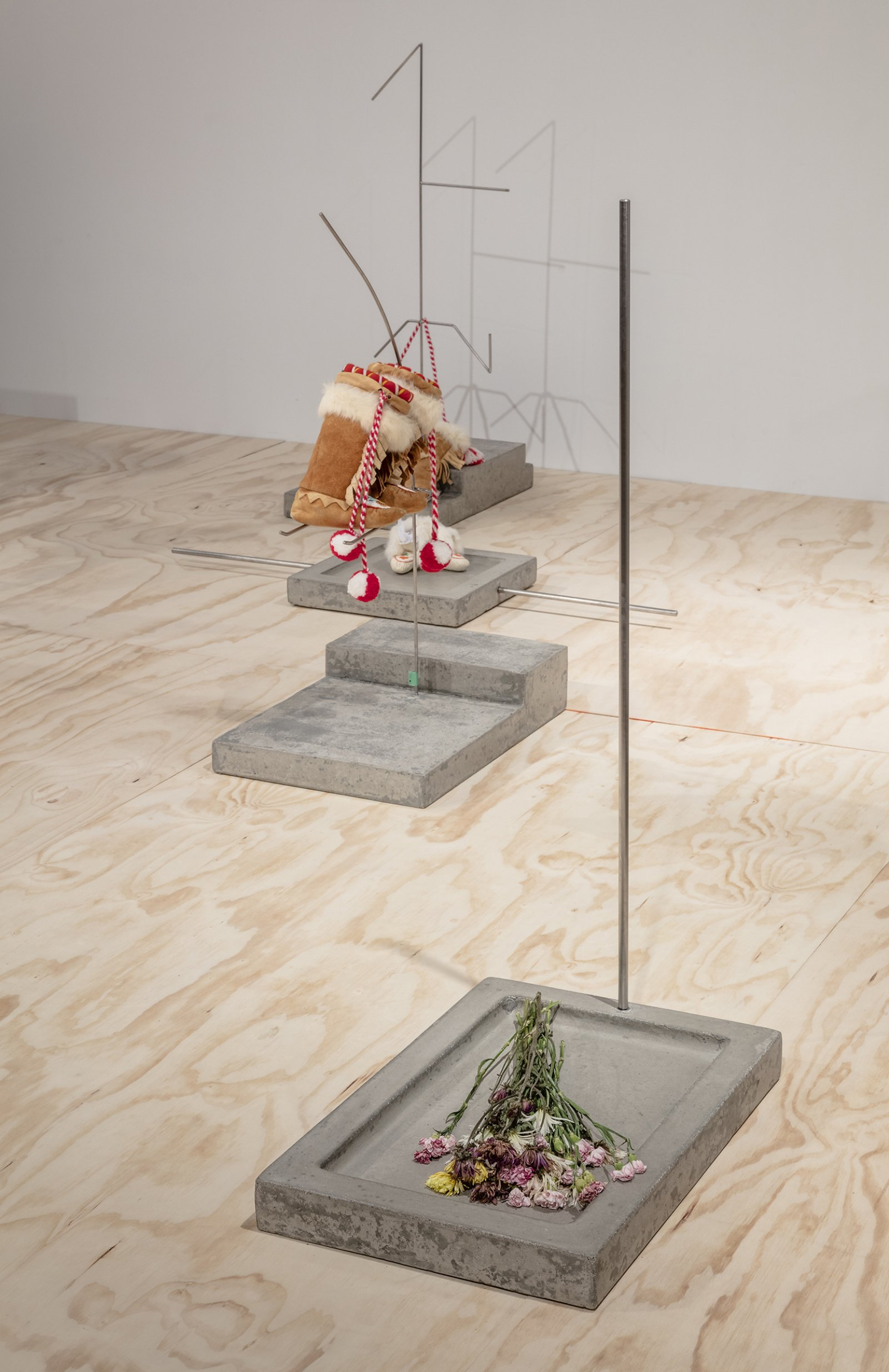 Duane Linklater, Speculative apparatus 7 for the work of nohkompan, 2016, concrete, stainless steel, flowers, 24 x 16 x 43 in. (61 x 41 x 109 cm)