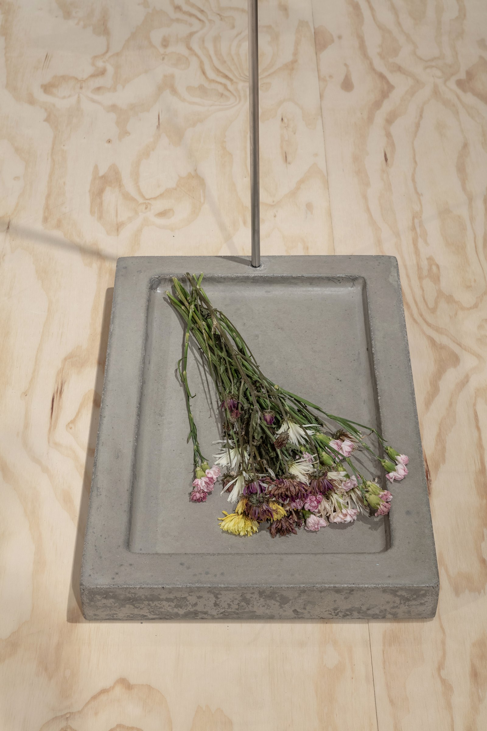Duane Linklater, Speculative apparatus 7 for the work of nohkompan (detail), 2016, concrete, stainless steel, flowers, 24 x 16 x 43 in. (61 x 41 x 109 cm)