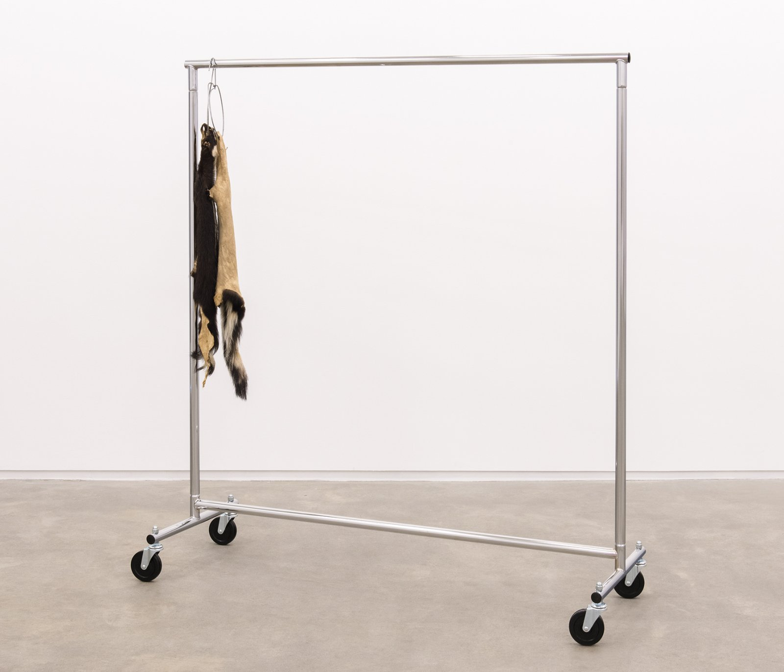 Duane Linklater, The marks left behind, 2014, skunk furs, garment rack, hangers, 66 x 60 x 20 in. (168 x 151 x 52 cm) by Duane Linklater