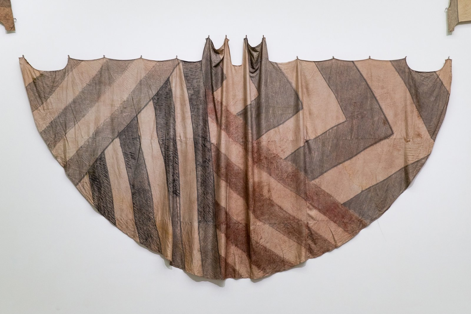 Duane Linklater, Tipi cover for deep forest dazzle / four on the floor for Tobias, 2018, digital print on hand-dyed linen, sumac, cedar, charcoal, nails, 117 x 230 in. (296 x 584 cm). Installation view, Post-Nature—A Museum as an Ecosystem, Taipei Biennial 2018, Taipei Fine Arts Museum, Taiwan, 2018