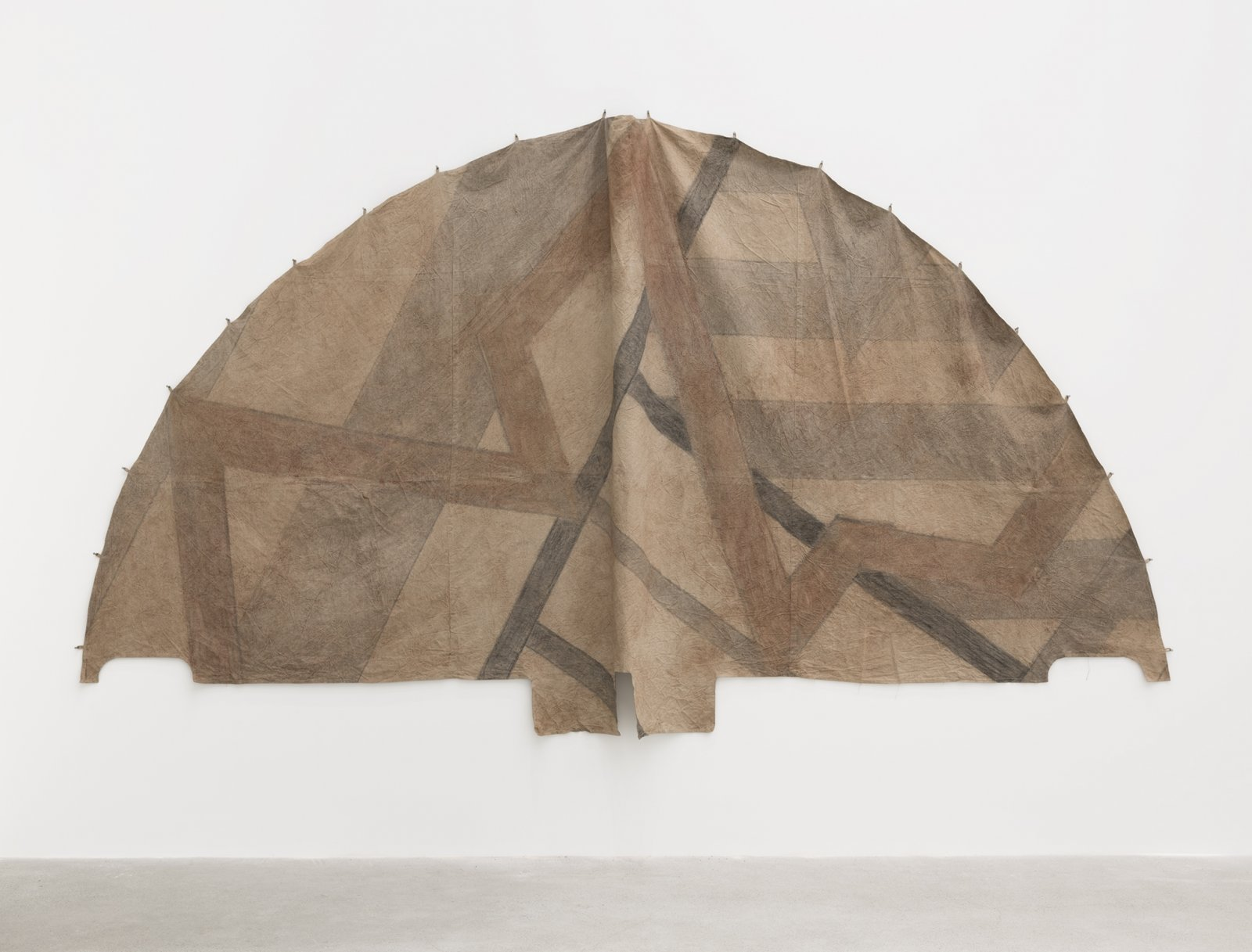 Duane Linklater, Tipi cover for new old geometries / little door for Sassa, 2018, digital print on hand-dyed linen, sumac, charcoal, nails, 110 x 210 in. (278 x 533 cm)