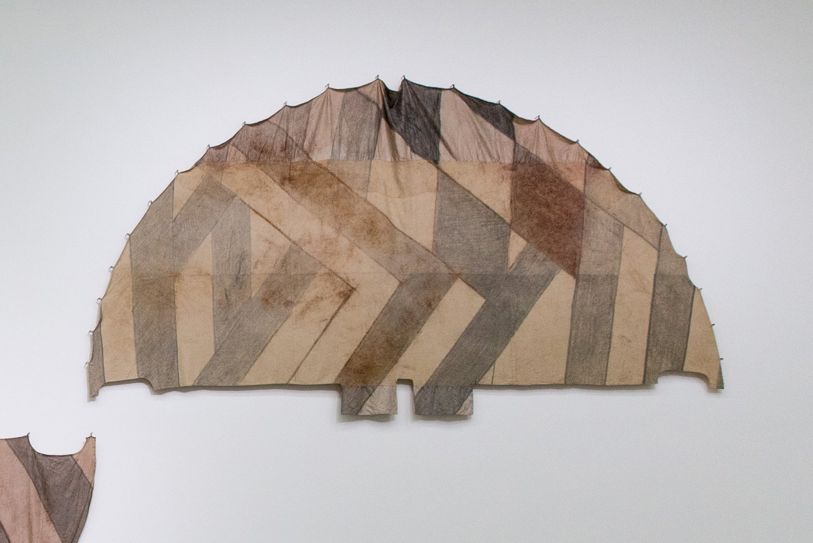 Duane Linklater, Tipi cover for unknown future horizon / Indian lemonade diamond for Mina, 2018, digital print on hand-dyed linen, cedar, sumac, charcoal, nails, 113 x 213 in. (287 x 541 cm). Installation view, Post-Nature—A Museum as an Ecosystem, Taipei Biennial 2018, Taipei Fine Arts Museum, Taiwan, 2018