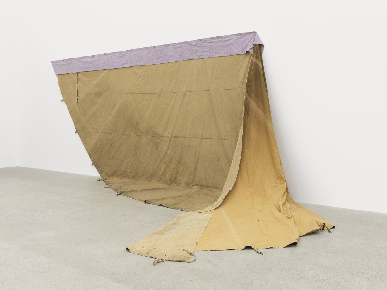 Duane Linklater, a gift from Doreen, 2016–2019, hand-dyed canvas, teepee canvas, blueberry extract, grommets, nails, 108 x 270 x 123 in. (274 x 686 x 312 cm)
