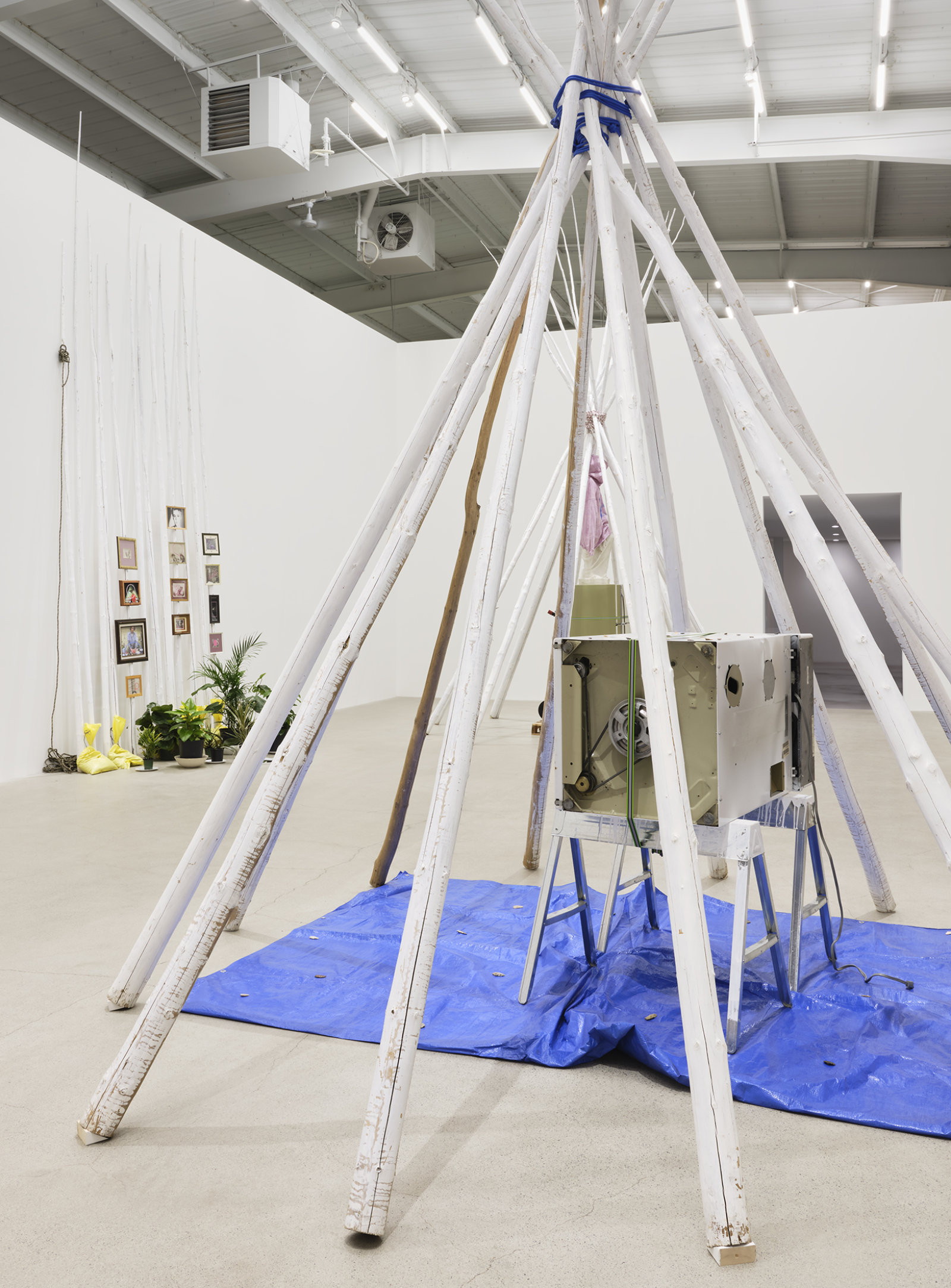 Duane Linklater, anteclovis (detail), 2020, teepee poles, paint, nylon rope, tarpaulin, steel sawhorses, washing machine, tie-down strap, arrowheads, 230 x 158 x 158 in. (584 x 401 x 401 cm)