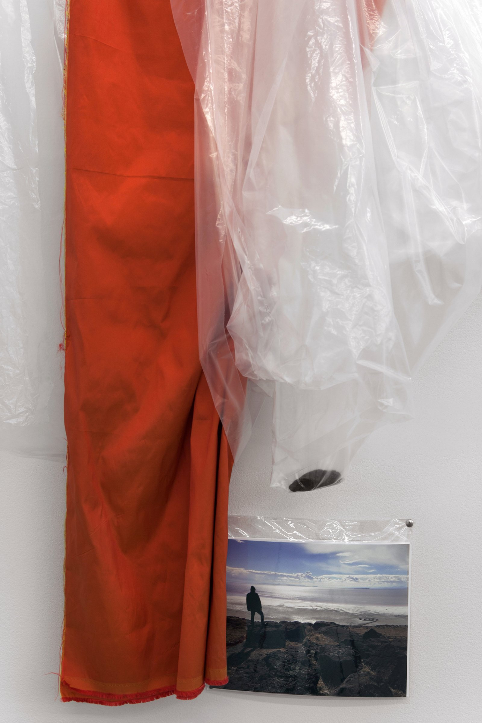 Duane Linklater,coup(detail), 2016, plastic sheeting, polyester cloth, stone from Spiral Jetty, thumb tacks, colour photograph, 67 x 43 x 8 in. (170 x 109 x 20 cm), dimensions variable