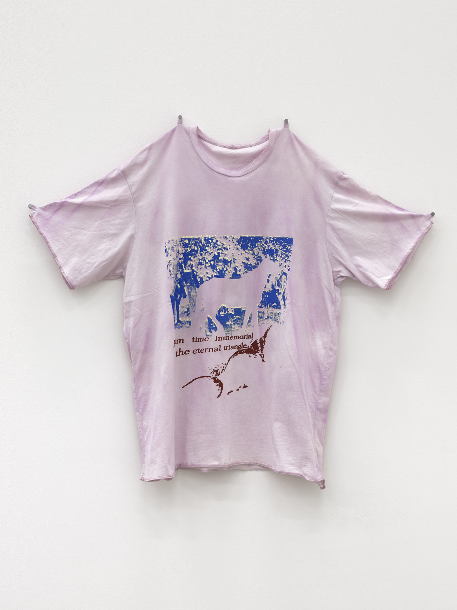 Duane Linklater, horses with intertitle, 2020, handmade t-shirt, cochineal dye, silkscreen, nails, 33 x 37 x 6 in. (84 x 94 x 14 cm)