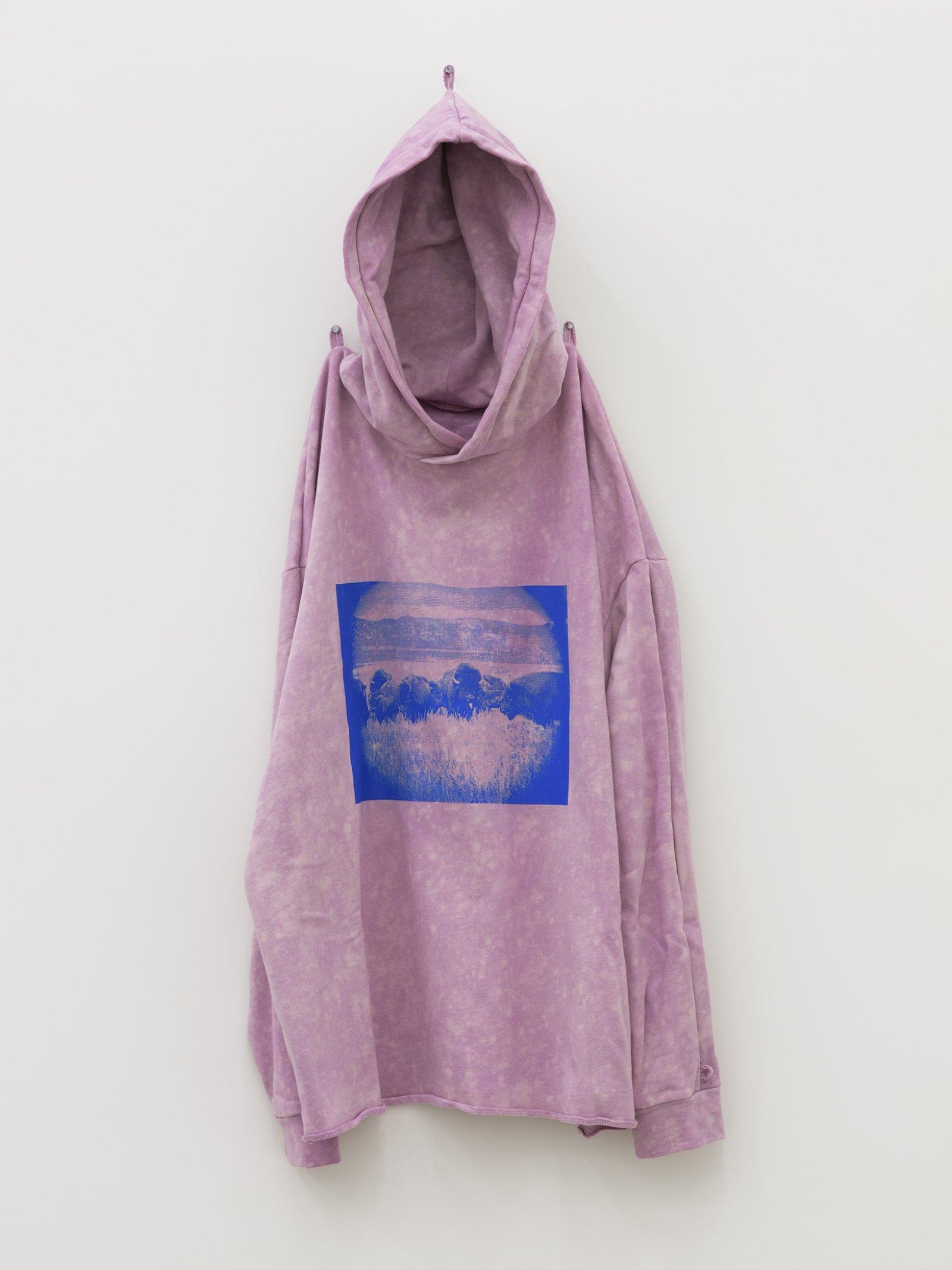 Duane Linklater, silentstar, delicacy, 2020, handmade hoodie, cochineal dye, silkscreen, nails, 56 x 20 x 5 in. (142 x 51 x 13 cm)