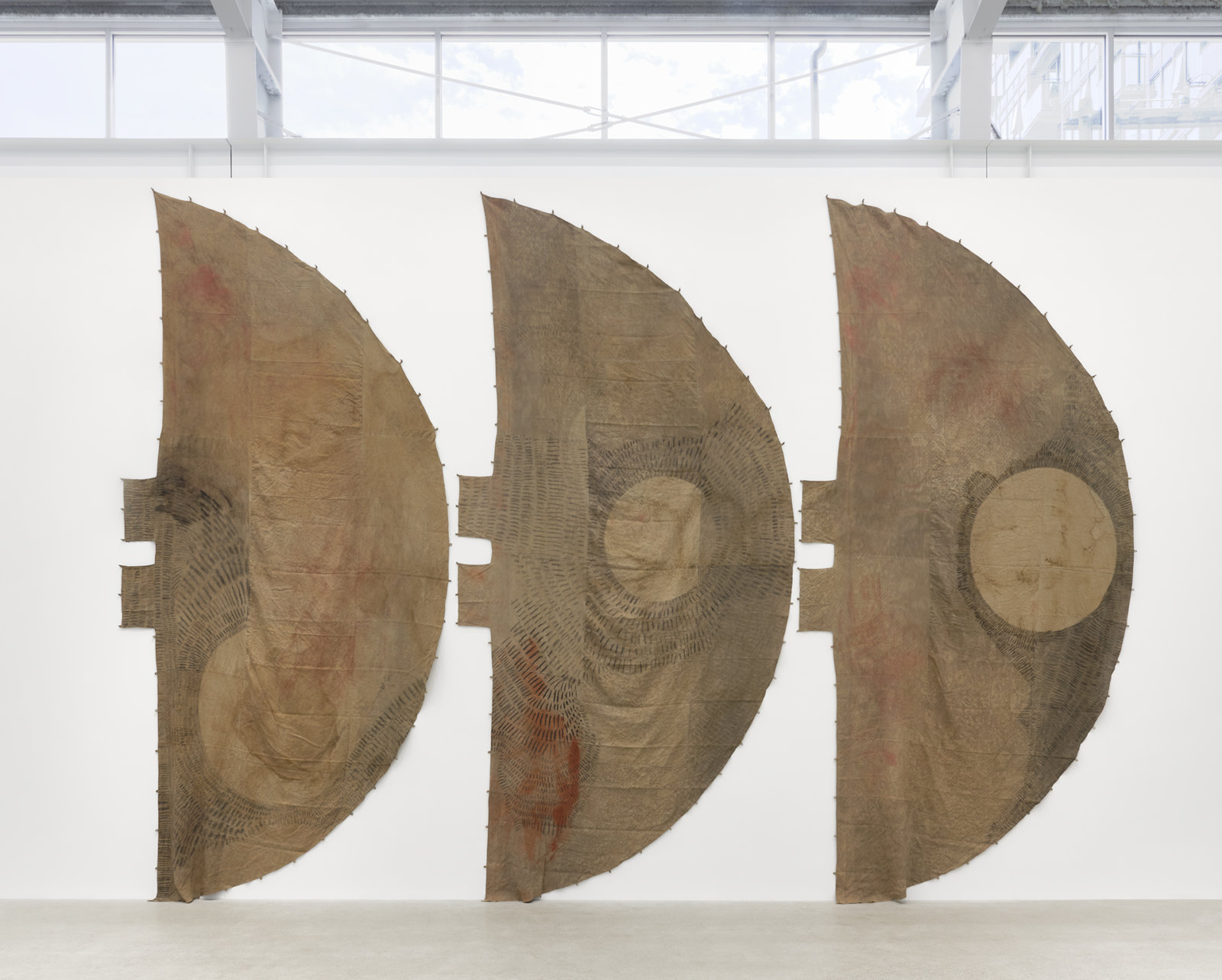 Duane Linklater, winter in america_no door_âkamenimok, 2020, digital print on hand dyed linen, black tea and sumac dye, charcoal, cup and saucer ochre, iron red pigment, dandelion, nails, 218 x 312 x 6 in. (554 x 793 x 15 cm)