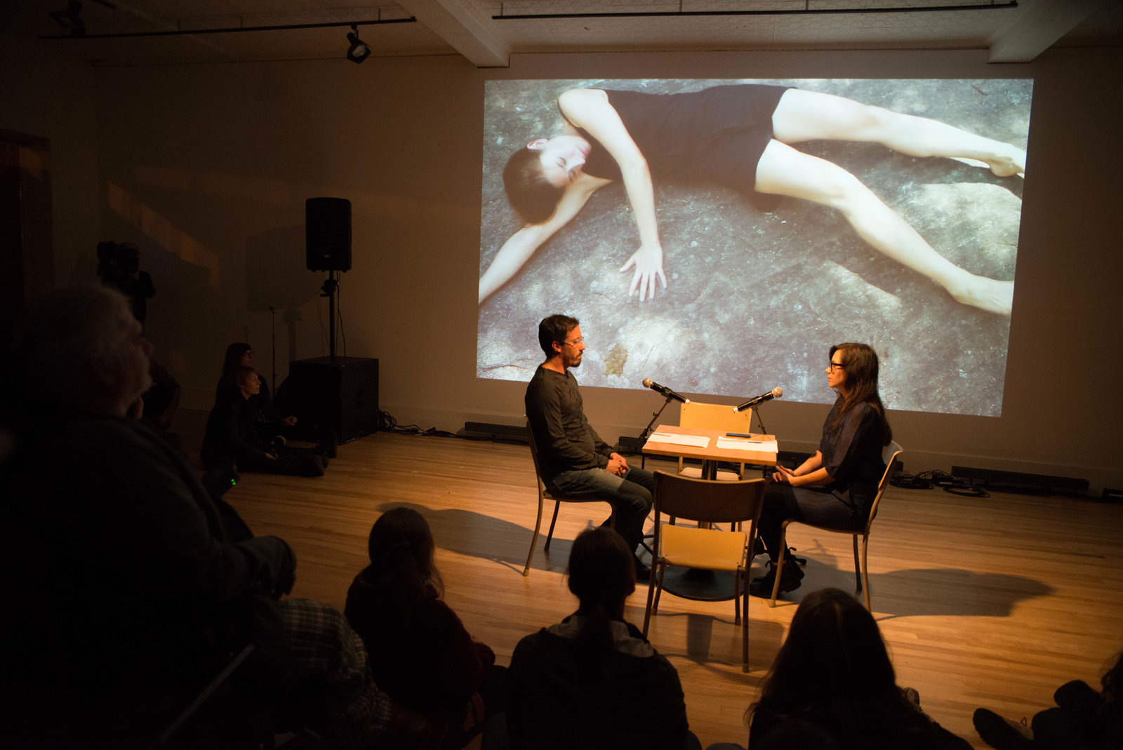 Tanya Lukin Linklater, the the, 2014–2016, performance of artist reading the long poem 'Not like us' with simultaneous translation by another reader into French, Spanish or Cree. Performance documentation, 7 Biennale d'art performatif, Rouyn-Noranda, Canada, 2014