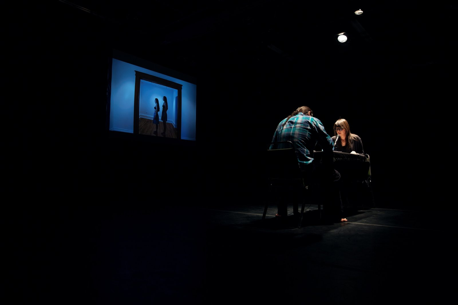Tanya Lukin Linklater, the the, 2014–2016, performance of artist reading the long poem 'Not like us' with simultaneous translation by another reader into French, Spanish or Cree. Performance documentation, Turn Out, Remai Modern, Saskatoon, Canada, 2016