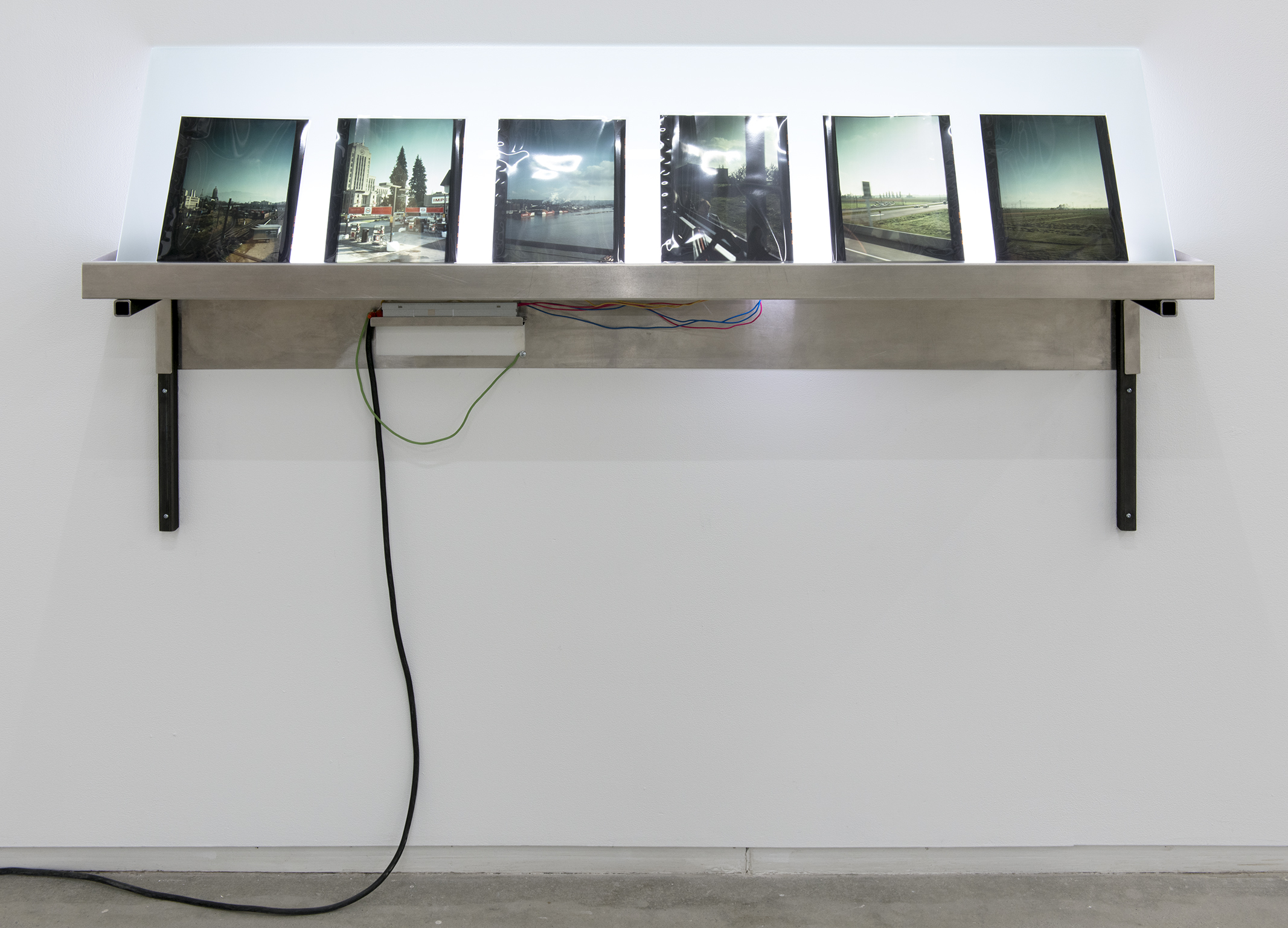 Christina Mackie, Lightbox, 2012, aluminum, steel, fluorescent lamps, glass, neoprene, photographic transparencies 1973, 30 x 66 x 8 in. (76 x 168 x 21 cm) by