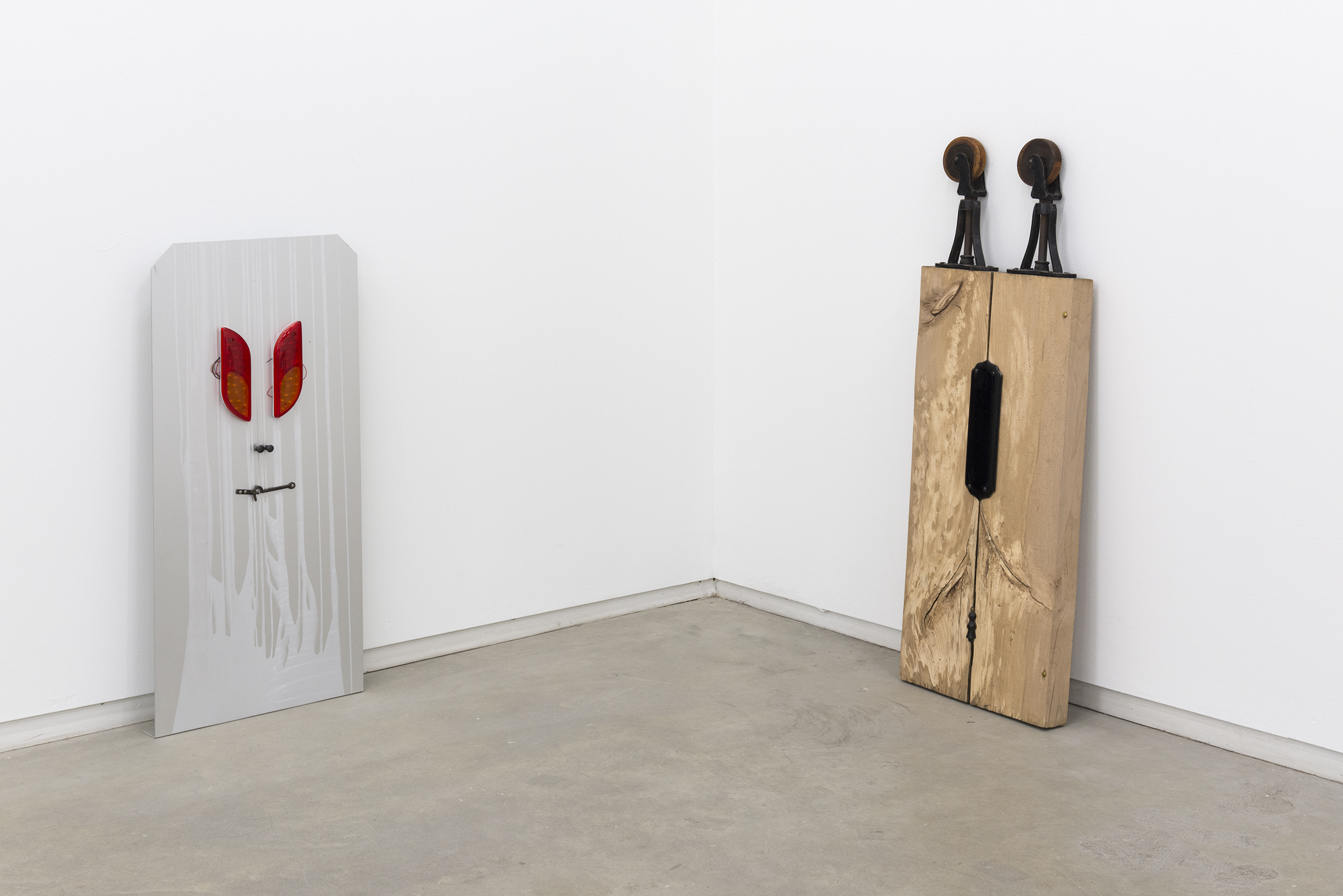Christina Mackie, ​Trestle Person II​, 2012, ​aluminum, plastic, steel​, 37 x 17 x 5 in. (94 x 43 x 12 cm​), and ​Trestle Person III​, 2012, cast iron, wood, ceramics, brass, 46 x 16 x 3 in. (116 x 39 x 6 cm)​ by