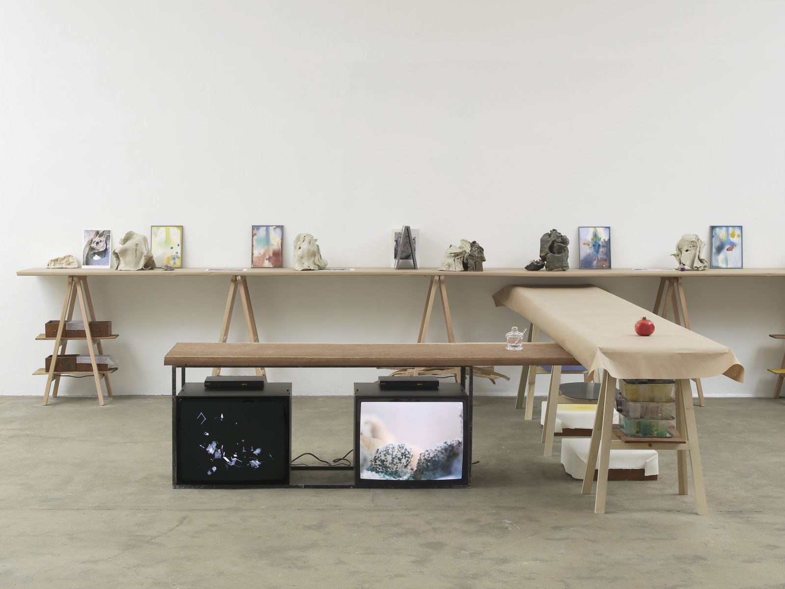 Christina Mackie, Fall Force and Planet, 2012, hantarax monitors, mahogany, glass jar, 2 DVDs, 4 minutes and 8 minutes, dimensions variable. Installation view, Painting the Weights, Chisenhale Gallery, London, UK, 2012 by Christina Mackie