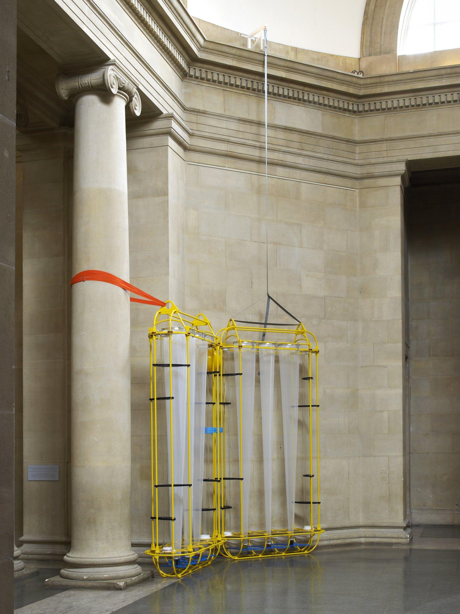 Christina Mackie, The Yellow Machines, 2015, steel, aluminum, acrylic, styrene, copper, stainless steel, nylon webbing, polyethylene, nylon, resin, rubber, 128 x 160 x 32 in. (326 x 406 x 80 cm) by Christina Mackie