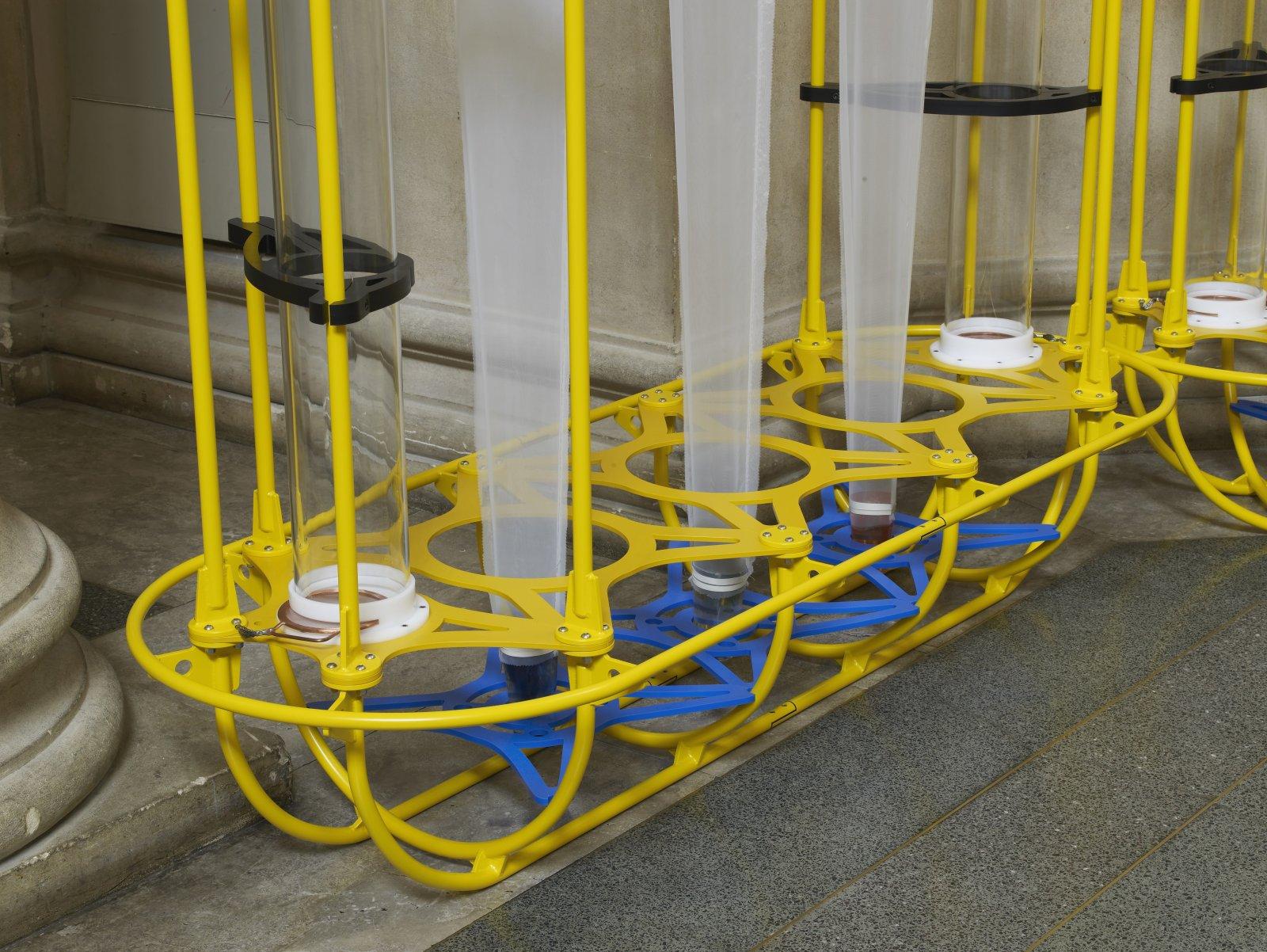 Christina Mackie, The Yellow Machines (detail), 2015, steel, aluminum, acrylic, styrene, copper, stainless steel, nylon webbing, polyethylene, nylon, resin, rubber, 128 x 160 x 32 in. (326 x 406 x 80 cm) by Christina Mackie