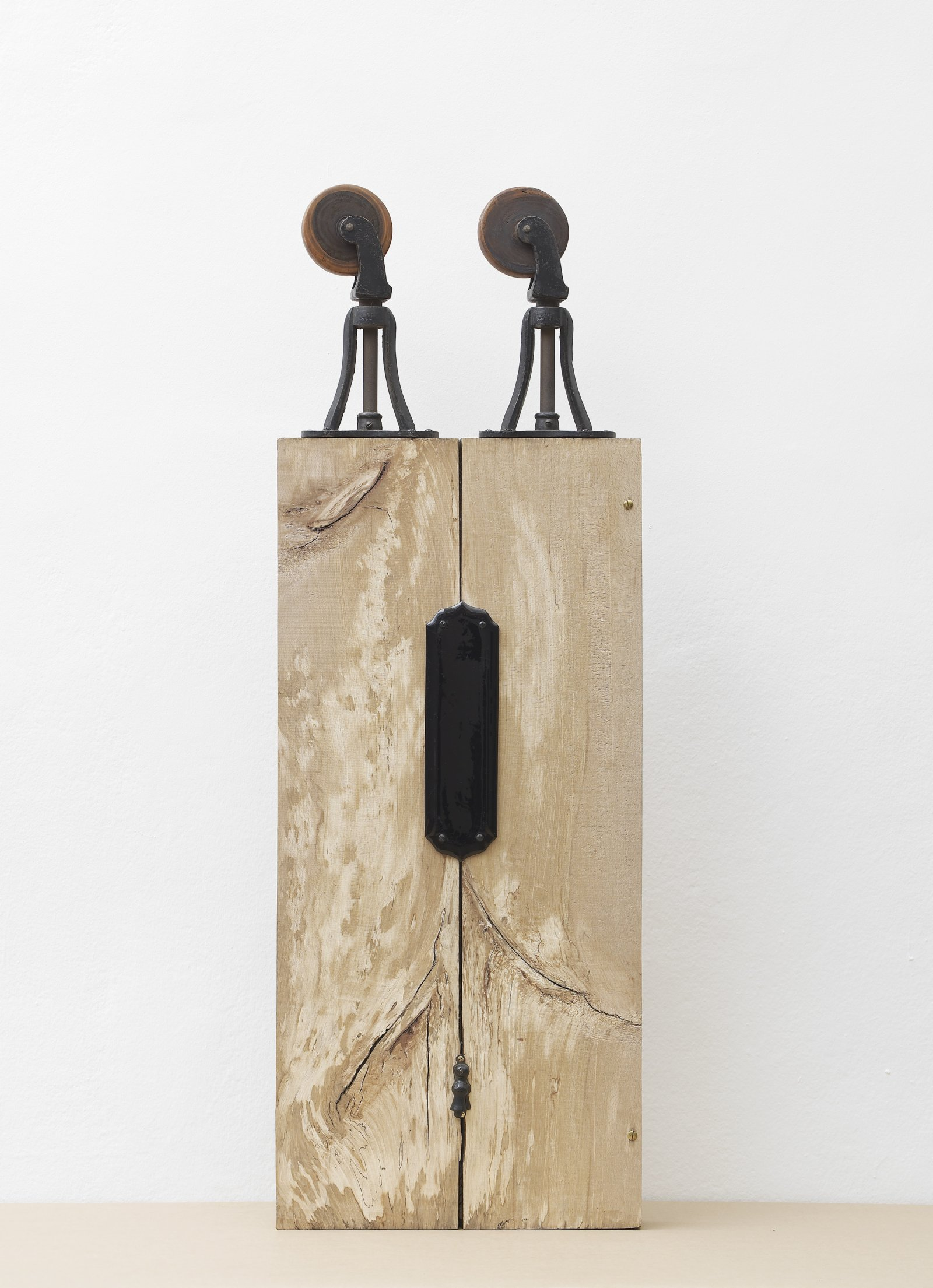 Christina Mackie, Trestle Person III, 2012, cast iron, wood, ceramics, brass, 46 x 16 x 3 in. (116 x 39 x 6 cm). Installation view, Painting the Weights, Chisenhale Gallery, London, UK, 2012 by Christina Mackie